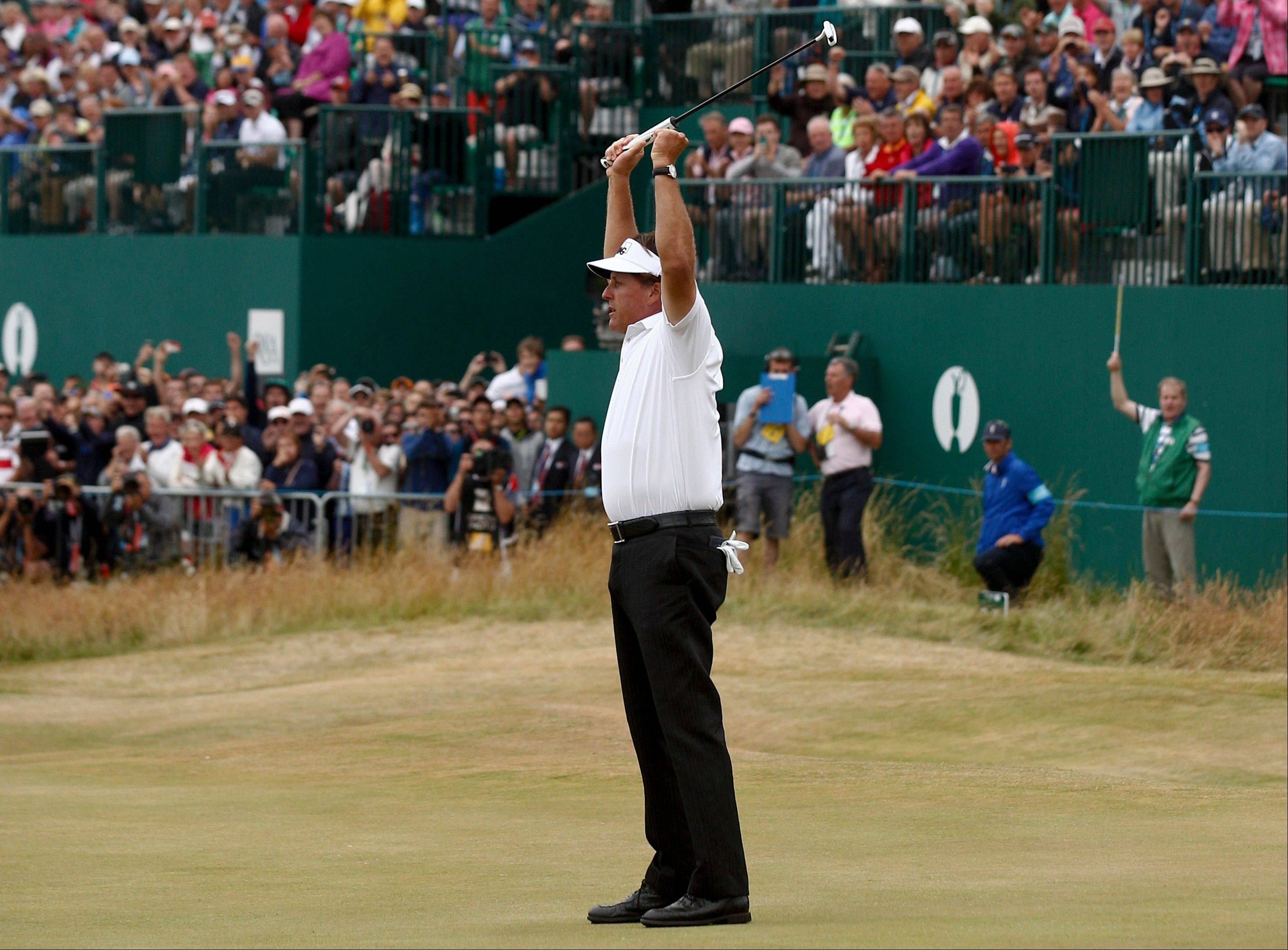 Phil Mickelson celebrates Sunday after his final putt on the 18th green during the final round of the British Open at Muirfield.