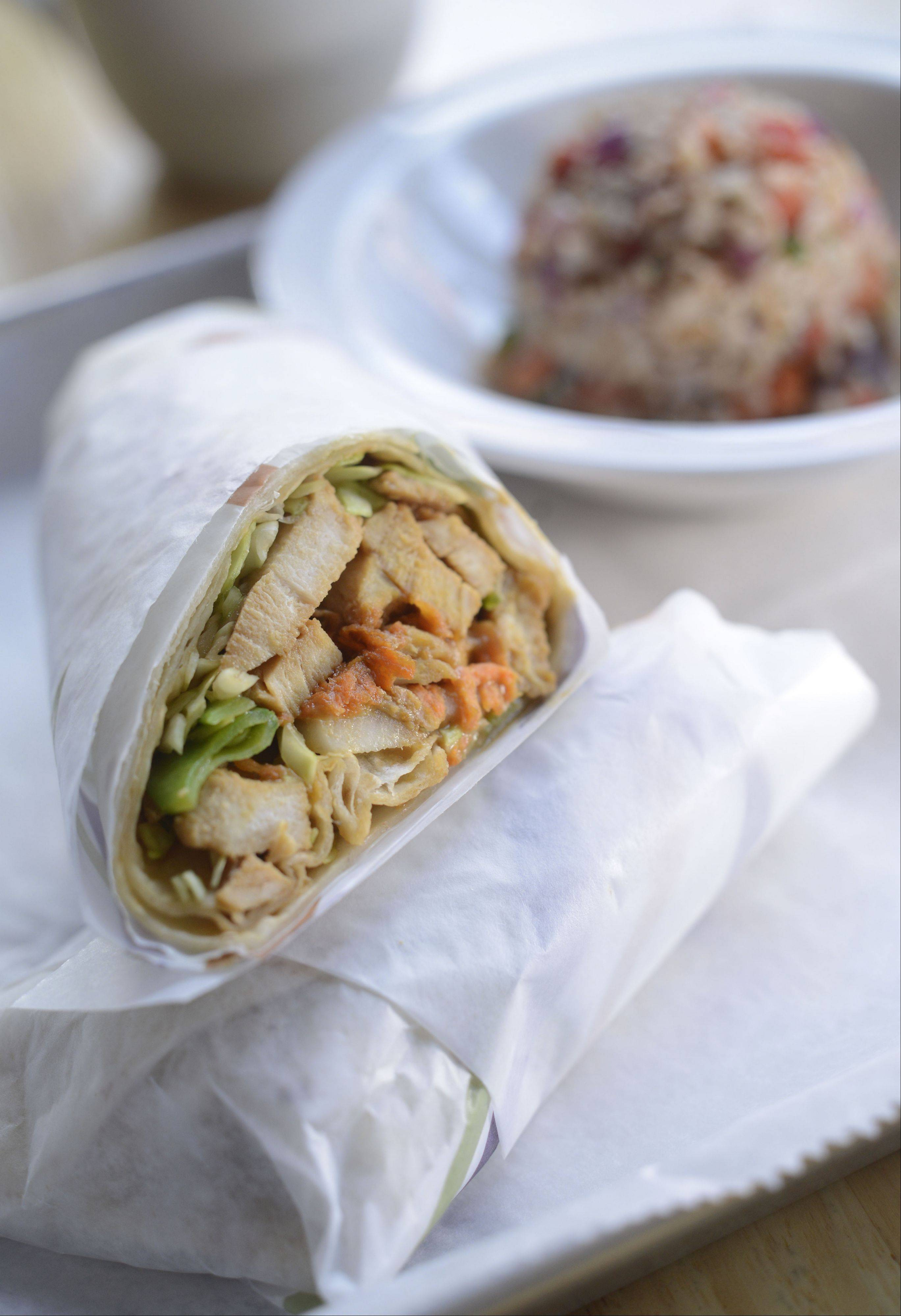 Honey soy glazed chicken breast, greens, baby spinach, pea pods and chow mein noodles make for a flavor-filled wrap at On the Side in Elgin.