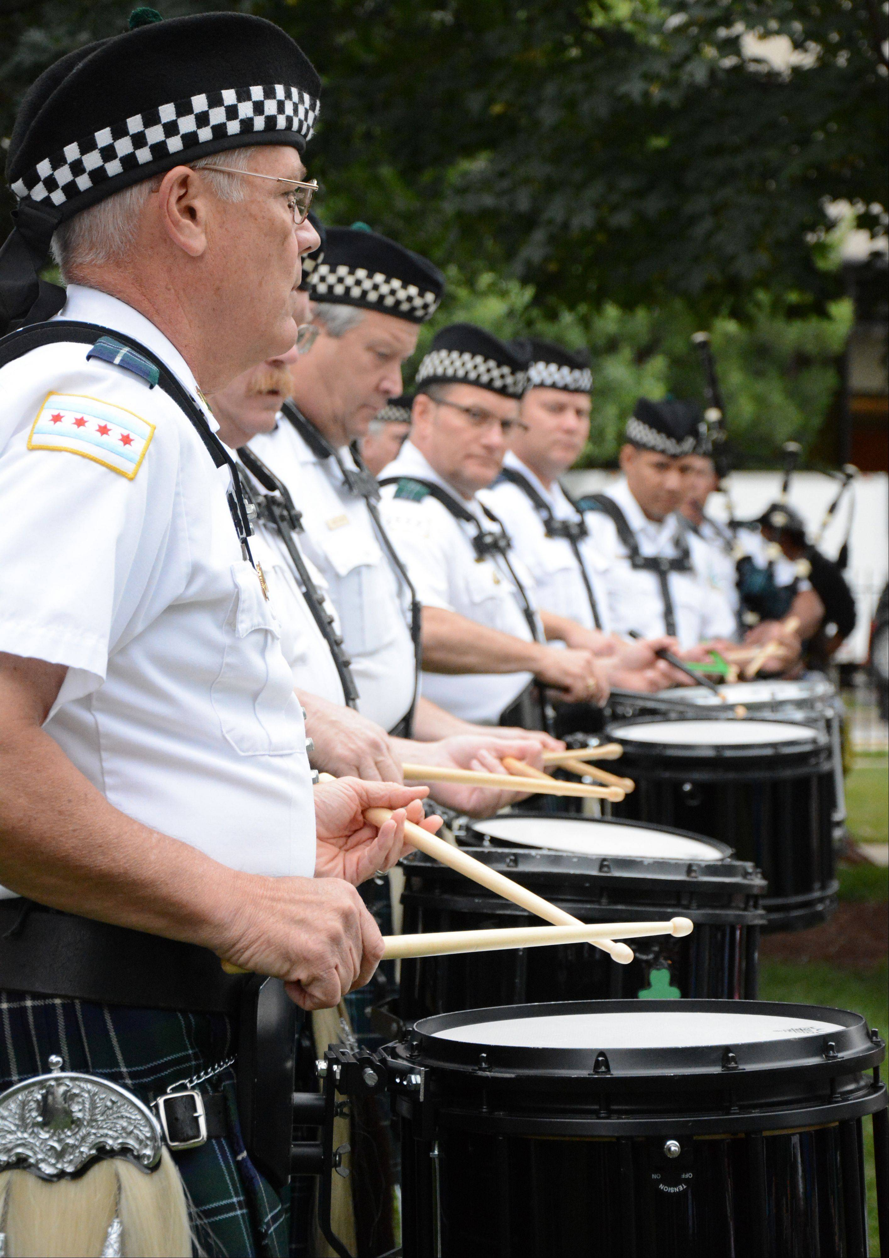 Dave Dvorak/ddvorak@dailyherald.comThe Chicago Police Pipes and Drums band perform at the Arlington Heights Irish Fest Saturday, July 27.