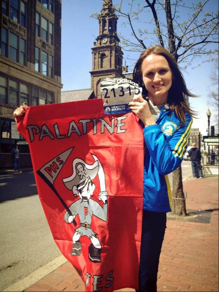 Making the best of the tragedy, Kimberly Grauer shows the high school's mascot flag in Boston while waiting to come home after the Boston Marathon was cut short by a terrorist attack.