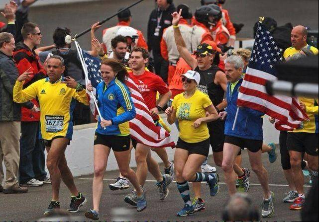 Kimberly Grauer leads a group of runners before the Indianapolis 500 in memory of the Boston Marathon attack.