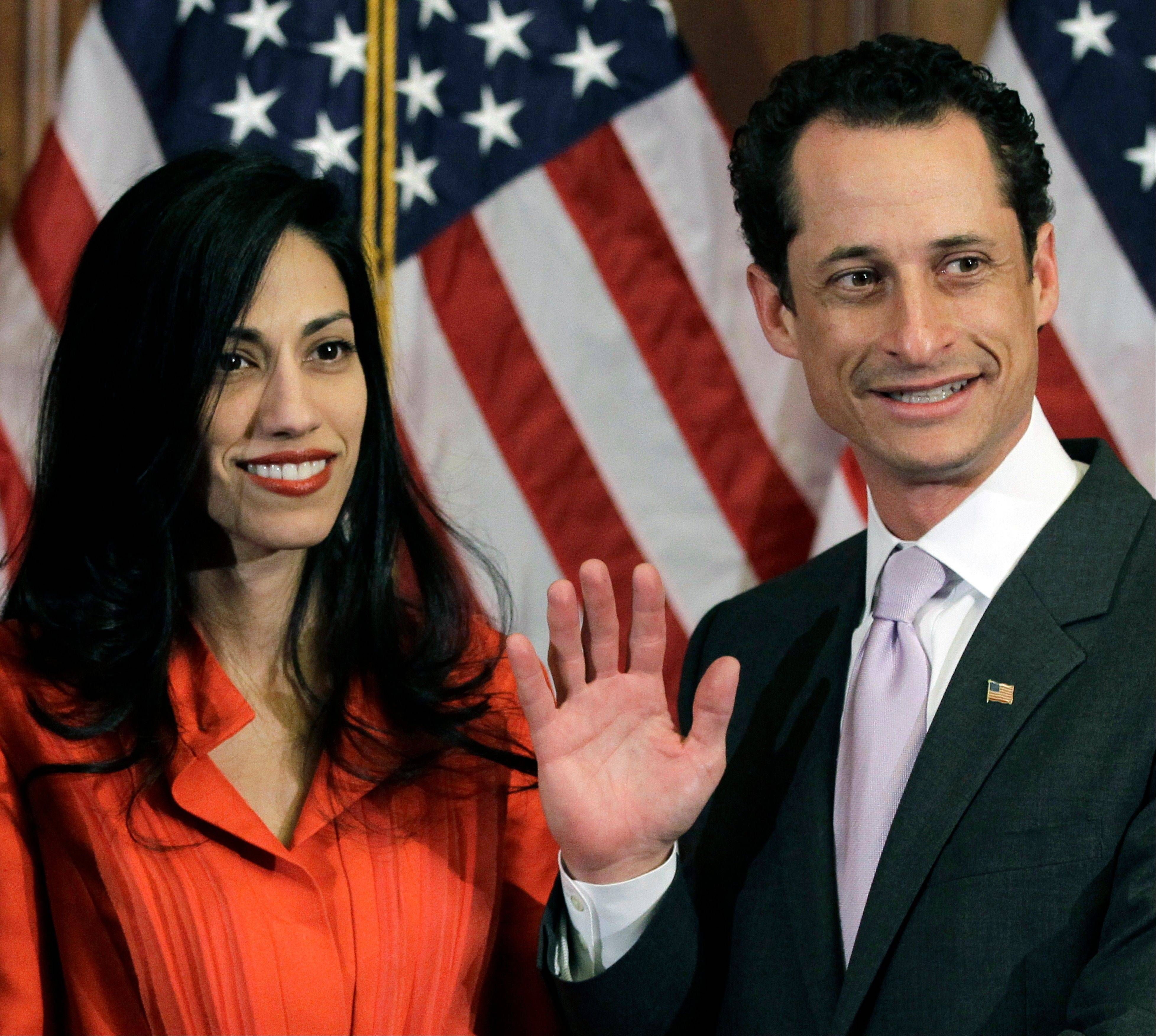 Anthony Weiner and his wife Huma Abedin pose for photographs after the ceremonial swearing in of the 112th Congress on Capitol Hill in Washington.