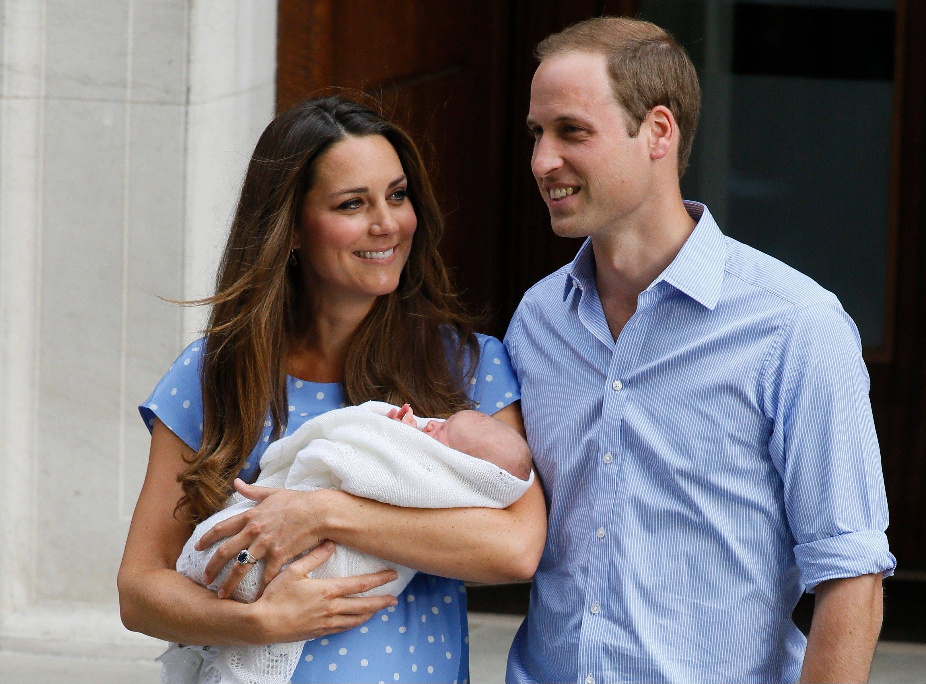Britain's Prince William, right, and Kate, Duchess of Cambridge hold the Prince of Cambridge, Tuesday July 23, 2013, as they pose for photographers outside St. Mary's Hospital exclusive Lindo Wing in London.