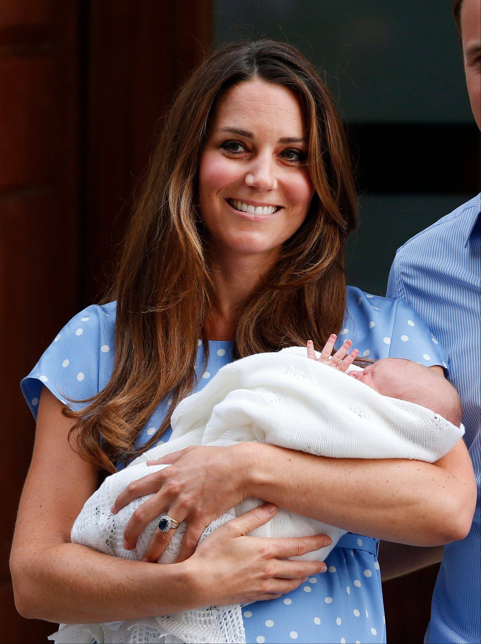 Kate, Duchess of Cambridge holds the Prince of Cambridge, Tuesday July 23, 2013, as she poses for photographers.