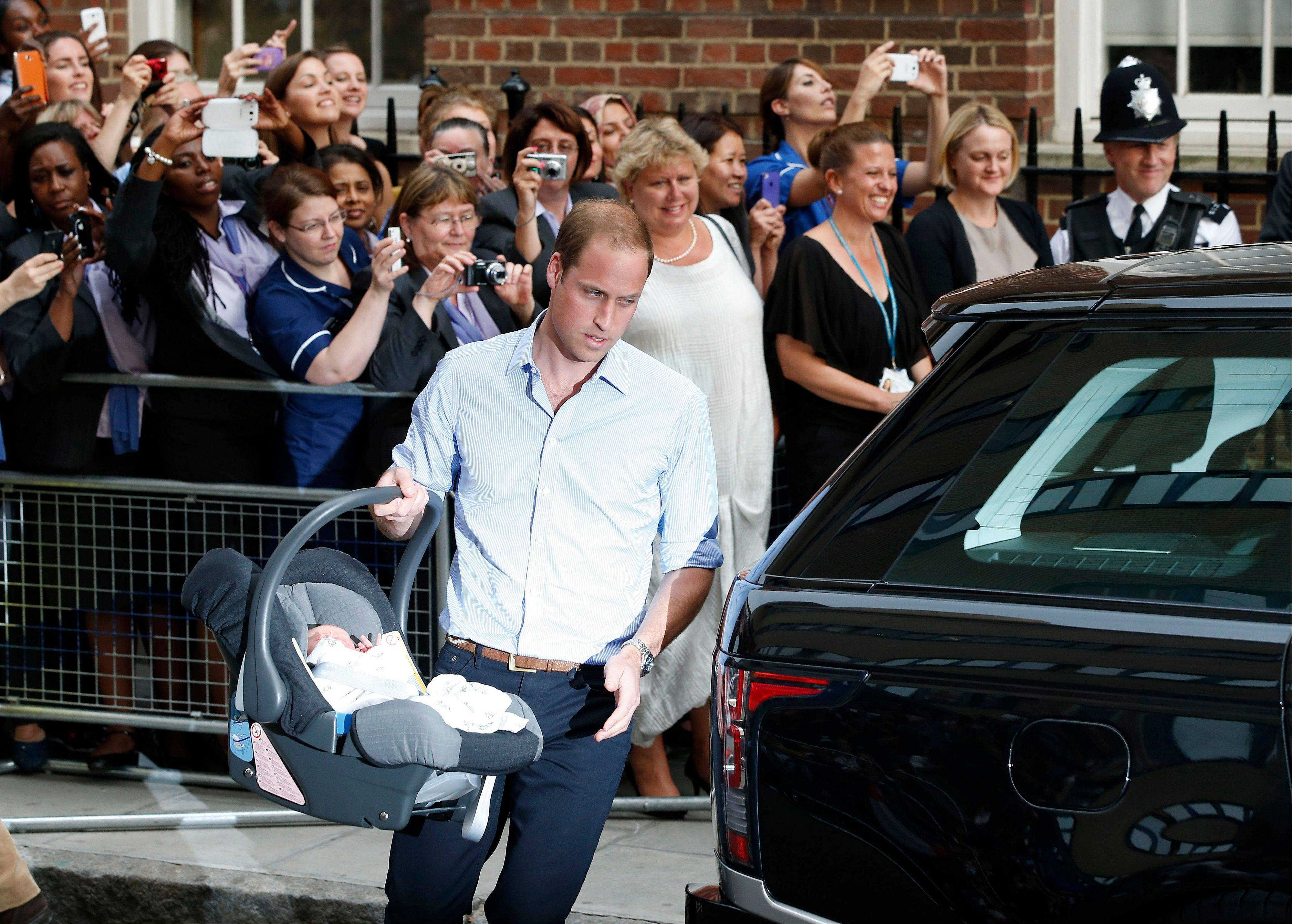 ASSOCIATED PRESSBritain's Prince William carries his son the Prince of Cambridge into a car outside St. Mary's Hospital exclusive Lindo Wing in London.