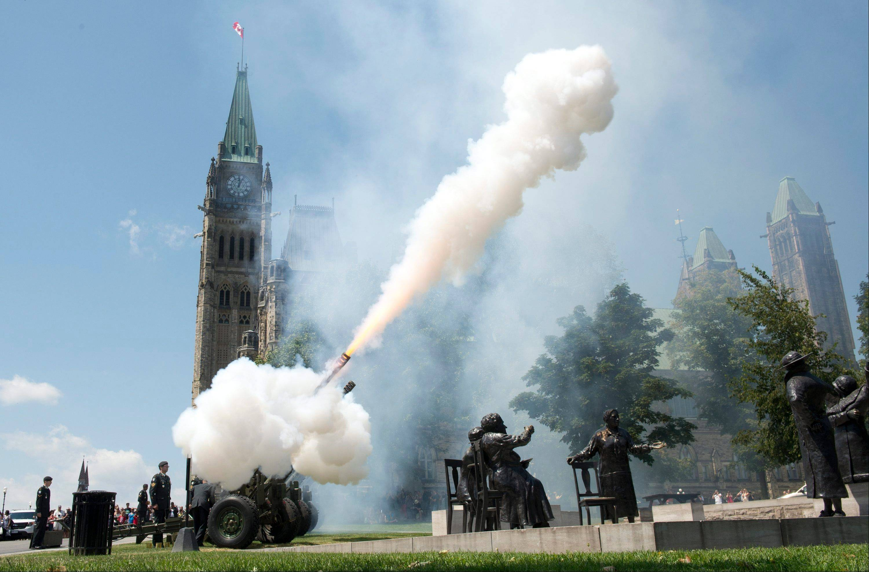 Using Four C3 Howitzers,l members of the 30th Field Regiment, Royal Canadian Artillery, fire a 21-gun Royal Salute in recognition of the birth of the Royal baby Tuesday July 23, 2013 on Parliament Hill in Ottawa.
