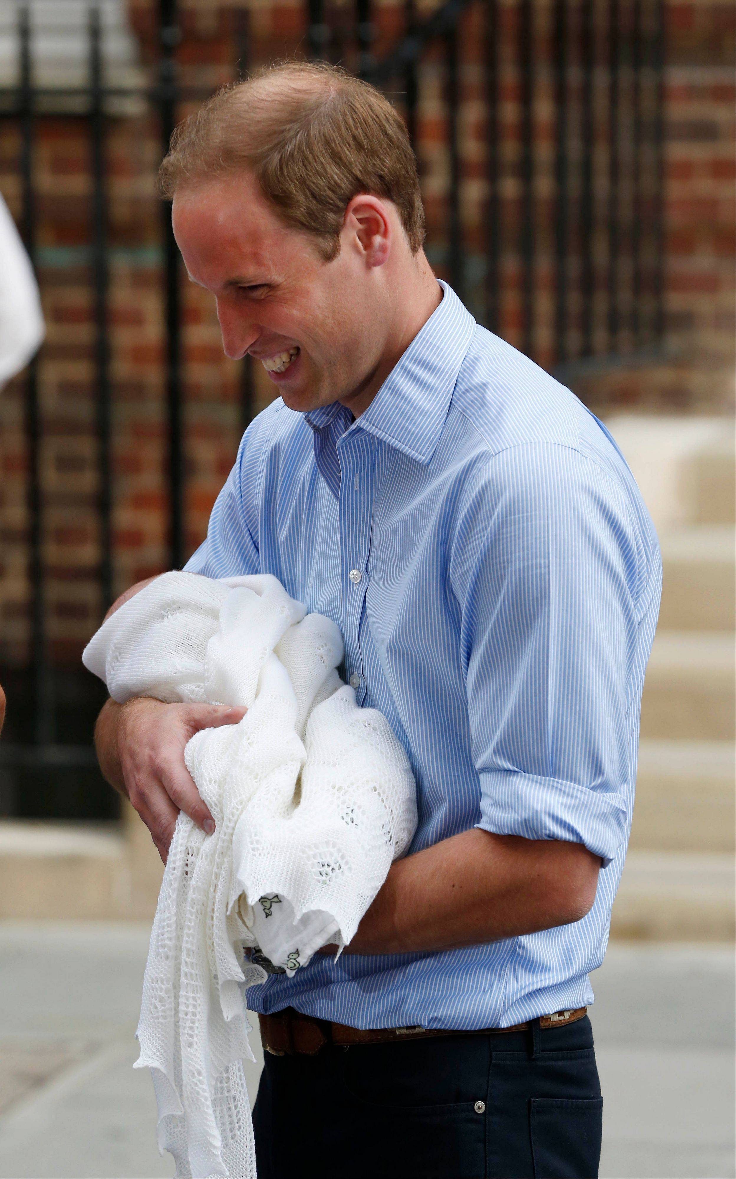 Britain's Prince William holds his son the Prince of Cambridge.