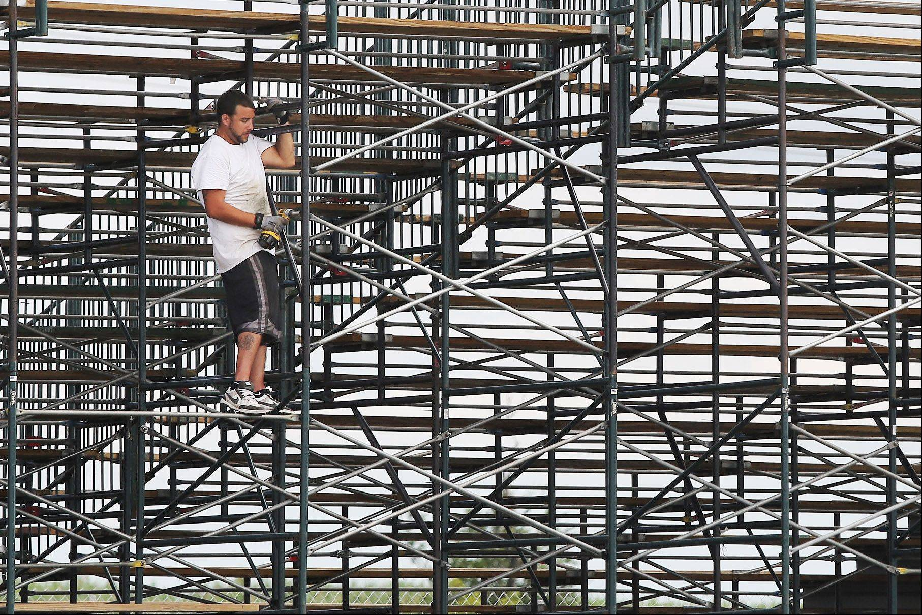 Laborer Matt Seidel works on the grandstand Tuesday in preparations for Wednesday's opening of the 2013 Lake County Fair in Grayslake.
