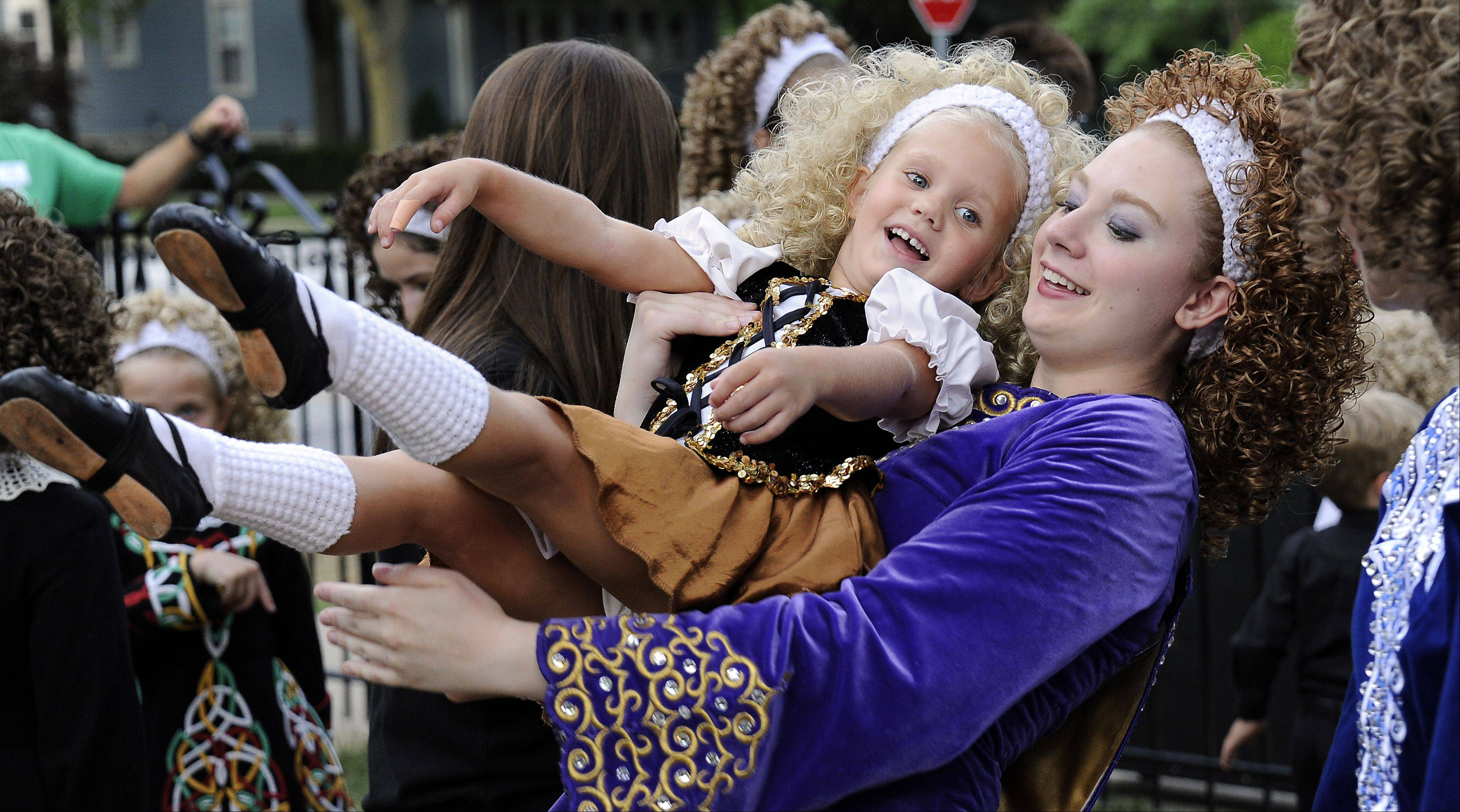 Erin Coleman, left, and Fiona Helgren dance around waiting to perform with the Trinity Dancers at last year's fest.