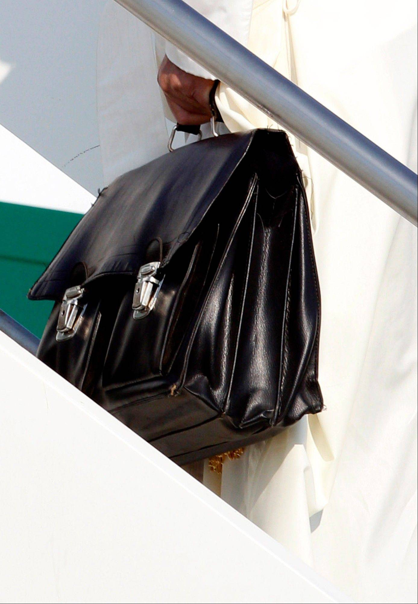 Keeping to his example that the Catholic church must be humble, Francis carried his own black hand luggage. He even kept holding it with his left hand while he used his left to shake hands with some of the VIPs who turned out to wish him well.