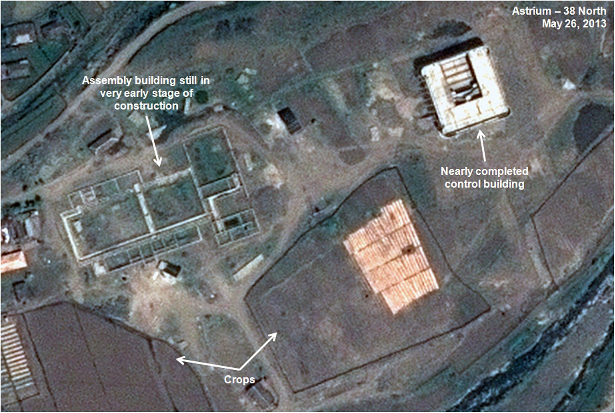 This May 26, 2013, satellite image shows an unfinished new missile assembly building, top left, and control center, top right, at the Tonghae facility in North Korea. An eight-month construction standstill at the North Korean site meant to launch bigger and better long-range rockets may signal Pyongyang is slowing or even stopping development of larger rockets, according to a new analysis of recent satellite imagery. (AP Photo/Astrium -- 38 North) CREDIT MANDATORY