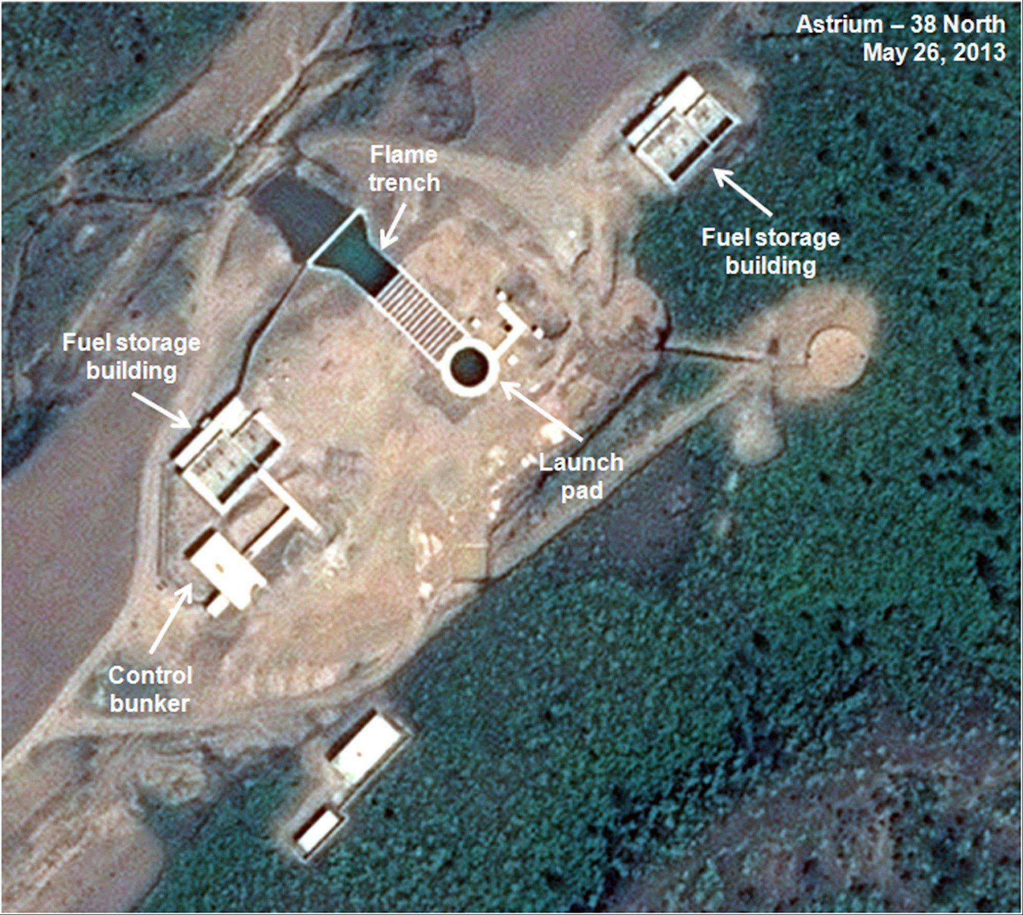 This May 26, 2013, satellite image shows an unfinished new launchpad, center, at the Tonghae facility in North Korea. An eight-month construction standstill at the North Korean site meant to launch bigger and better long-range rockets may signal Pyongyang is slowing or even stopping development of larger rockets, according to a new analysis of recent satellite imagery.