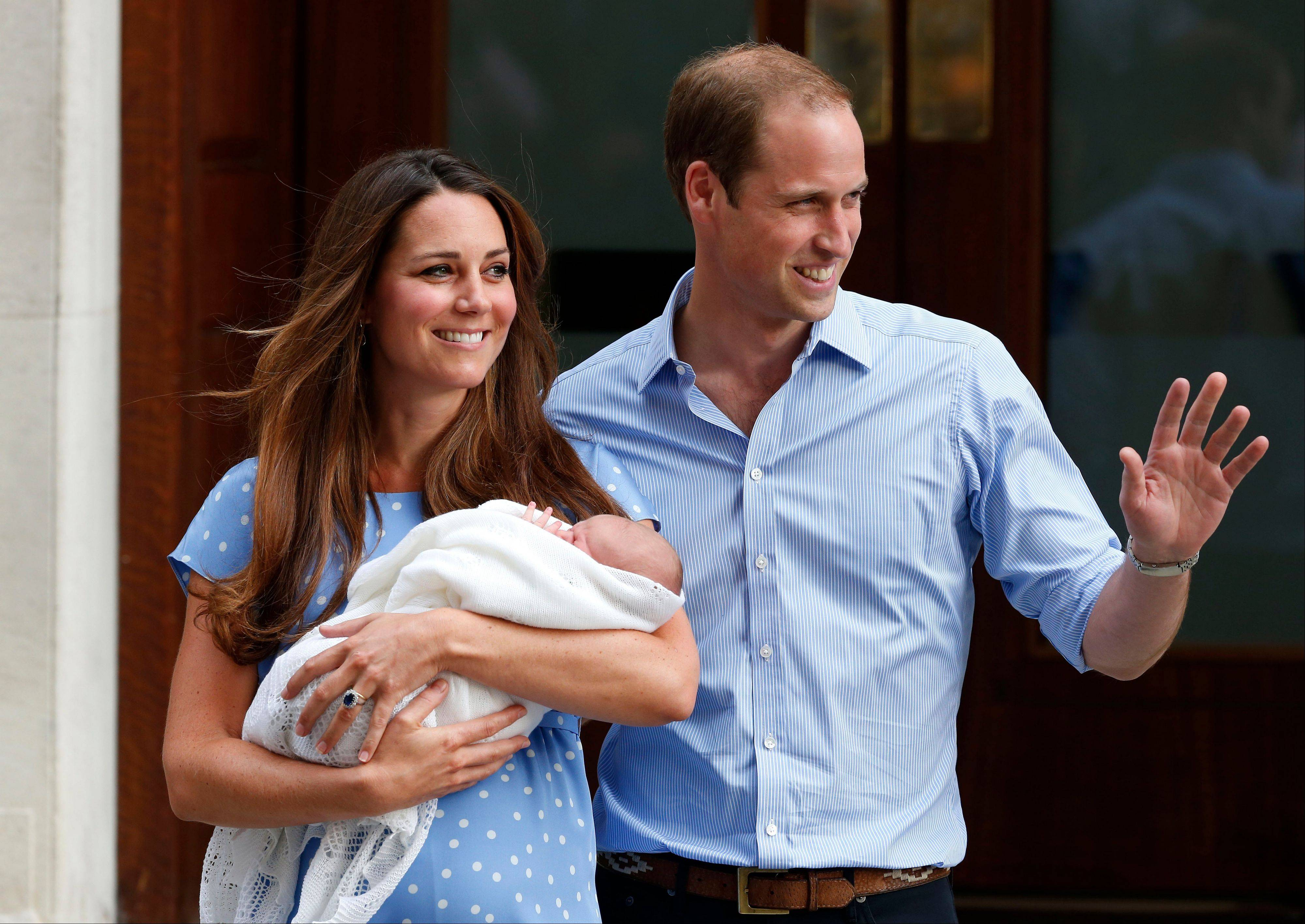 Britain's Prince William and Kate, Duchess of Cambridge hold the Prince of Cambridge, Tuesday as they pose for photographers outside St. Mary's Hospital exclusive Lindo Wing in London where the Duchess gave birth on Monday.