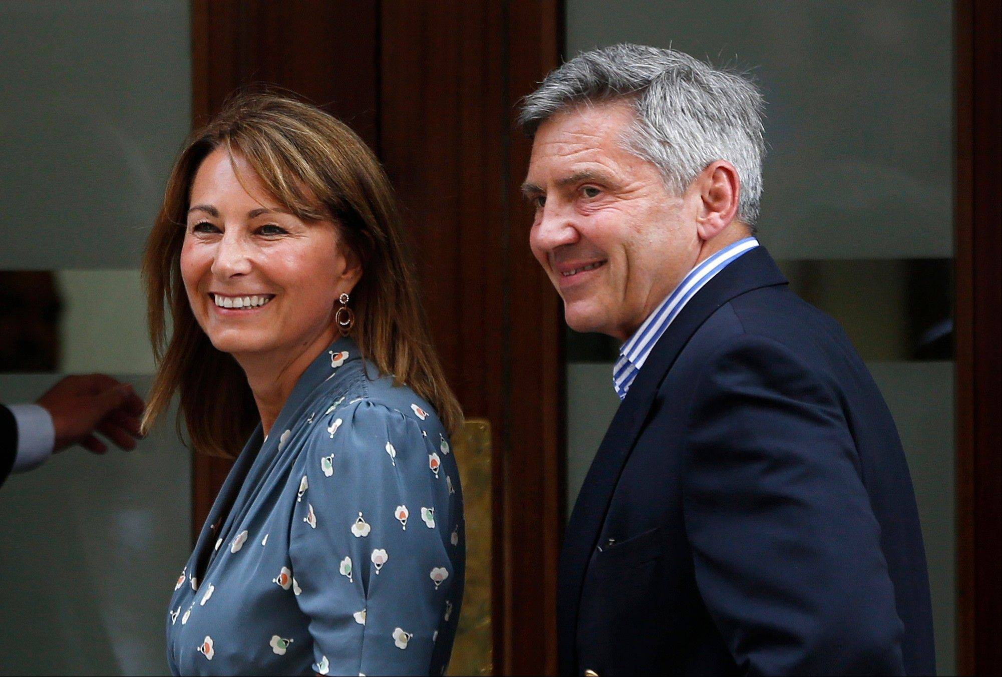 Carole and Michael Middleton, the parents Carole and Michael Middleton, the parents of Kate, Duchess of Cambridge, smile as they arrive at St. Mary's Hospital exclusive Lindo Wing in London, Tuesday.