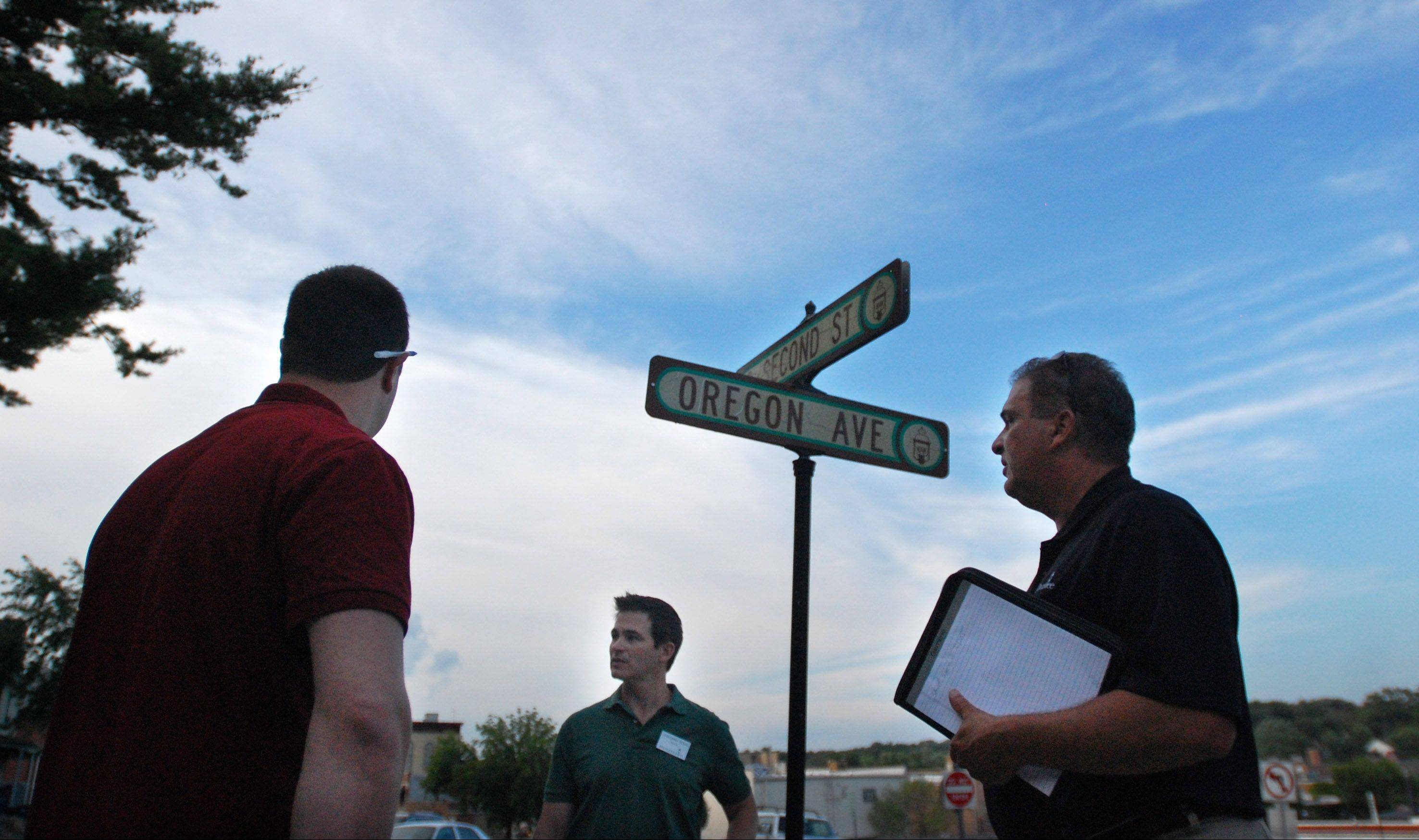 Trustee Daniel Wilbrant, Village President Chris Nelson and Village Manager Joe Cavallaro assess a street sign in West Dundee as apart of their community walking tour on Monday. The board members were in search of property maintenance issues, things that can be repaired and other neighborhood issues.
