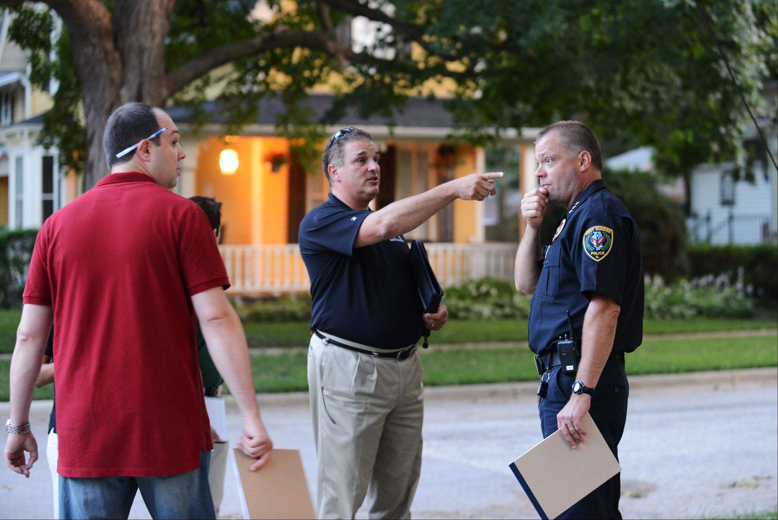 Trustee Daniel Wilbrant, Village Manager Joe Cavallaro and Police Chief Andrew Wieteska search for property maintenance issues on Monday. The West Dundee village president and board took walking tours of local neighborhoods in order to better understand their communities needs.