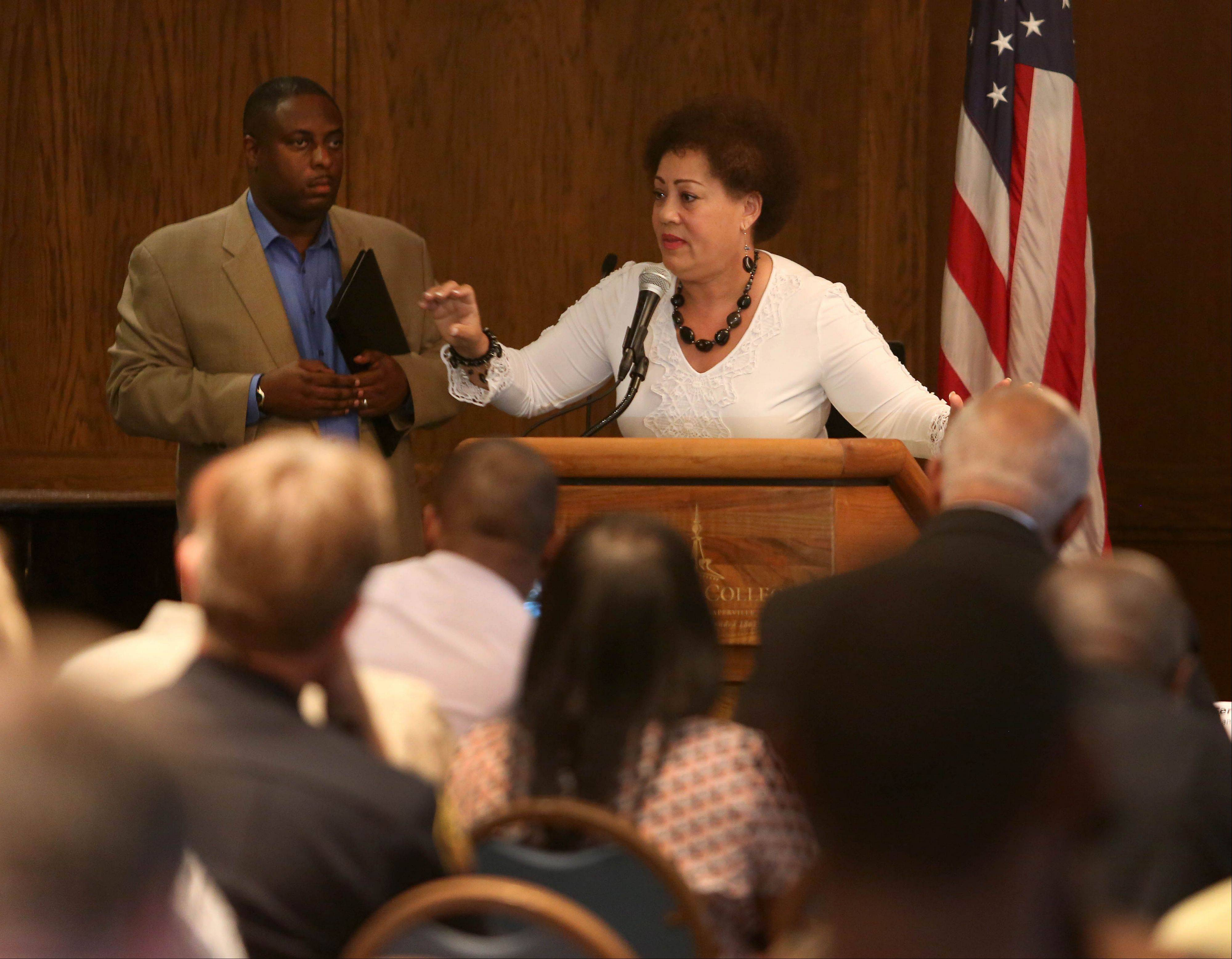 "Lourdes Ferrer, an education consultant, speaks at the DuPage County NAACP meeting titled ""Where do we go from here?"" on Tuesday at the Harold and Eva White Activities Center at North Central College in Naperville. Listening on the left is moderator Juan Thomas."