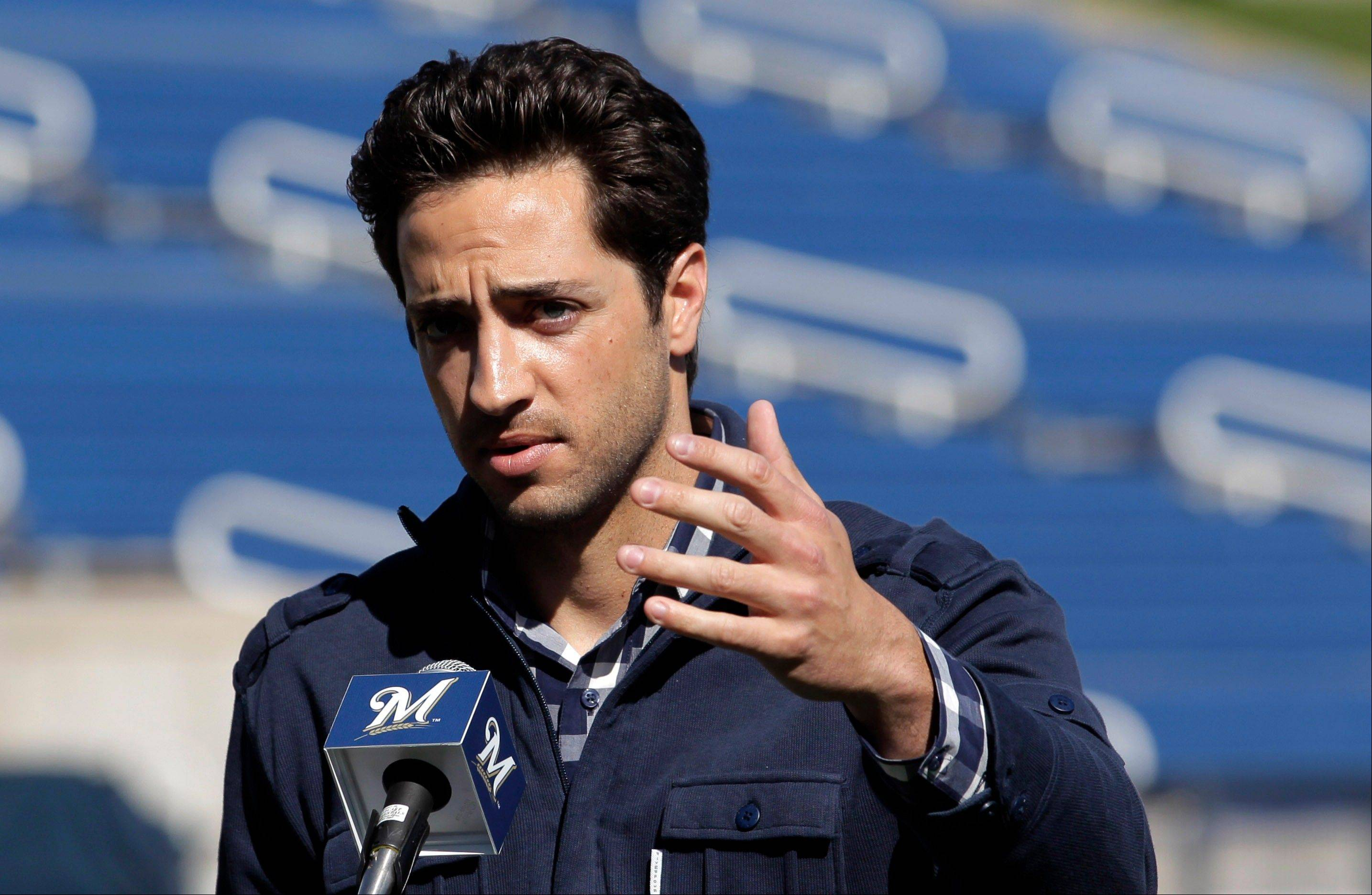 FILE - In this Feb. 24, 2012 file photo, Milwaukee Brewers' Ryan Braun speaks during a news conference at baseball spring training in Phoenix. The 2011 National League MVP was suspended without pay for the rest of the season and the postseason Monday, July 22, 2013, the start of sanctions involving players reportedly tied to a Florida clinic accused of distributing performance-enhancing drugs.