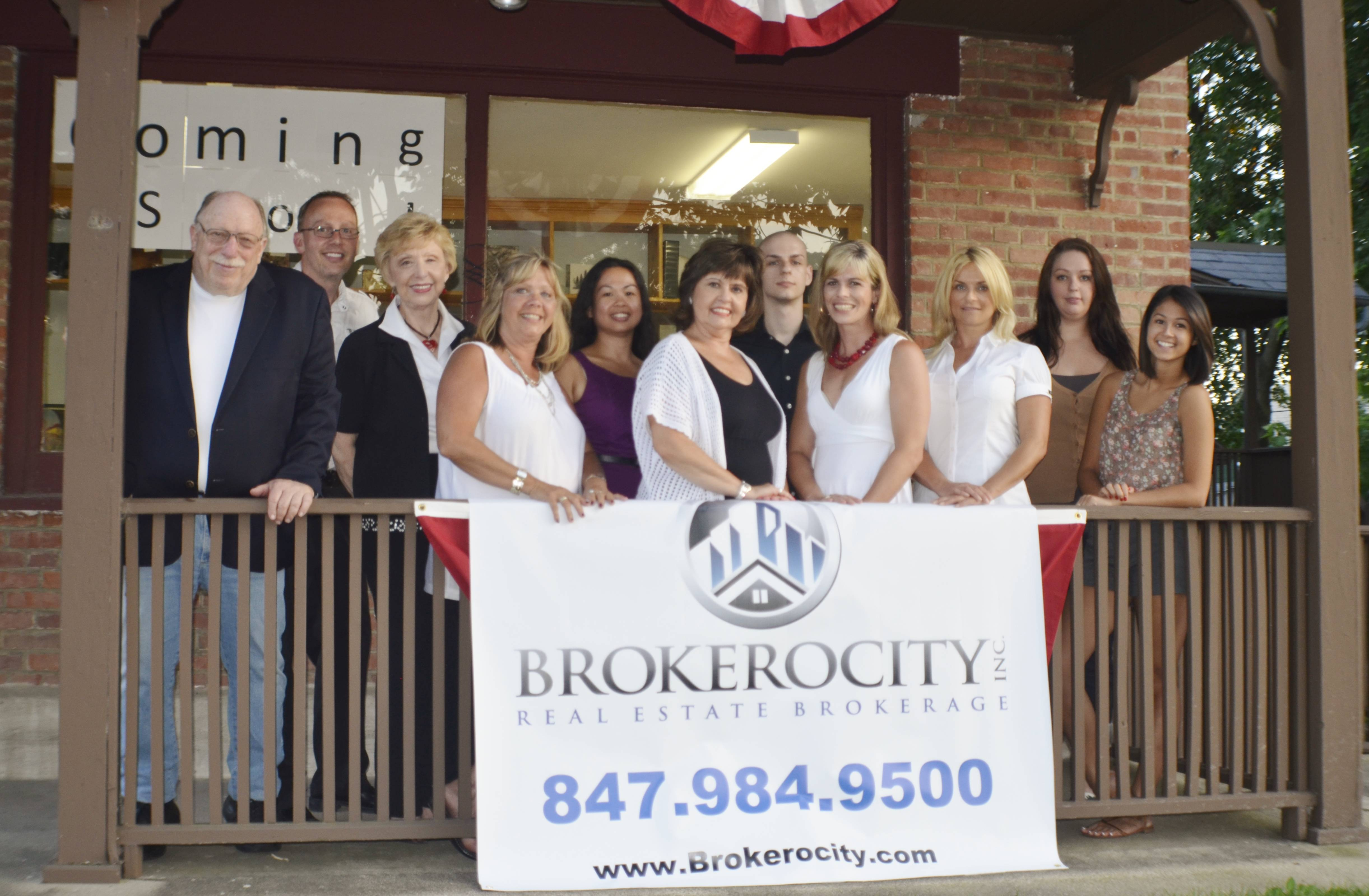 (Photograph identification: from left to right: Michael Schneider, Frank Richier, Broker-Owner, Donna Griffin, Bobbie St. John, Wendy  Litorja, Jean Steffens, Kyle Richier, Lisa Savage, Monica Wickham, Ashley Richier and  Alexis Rubenstein. Missing from photo is James Sances).