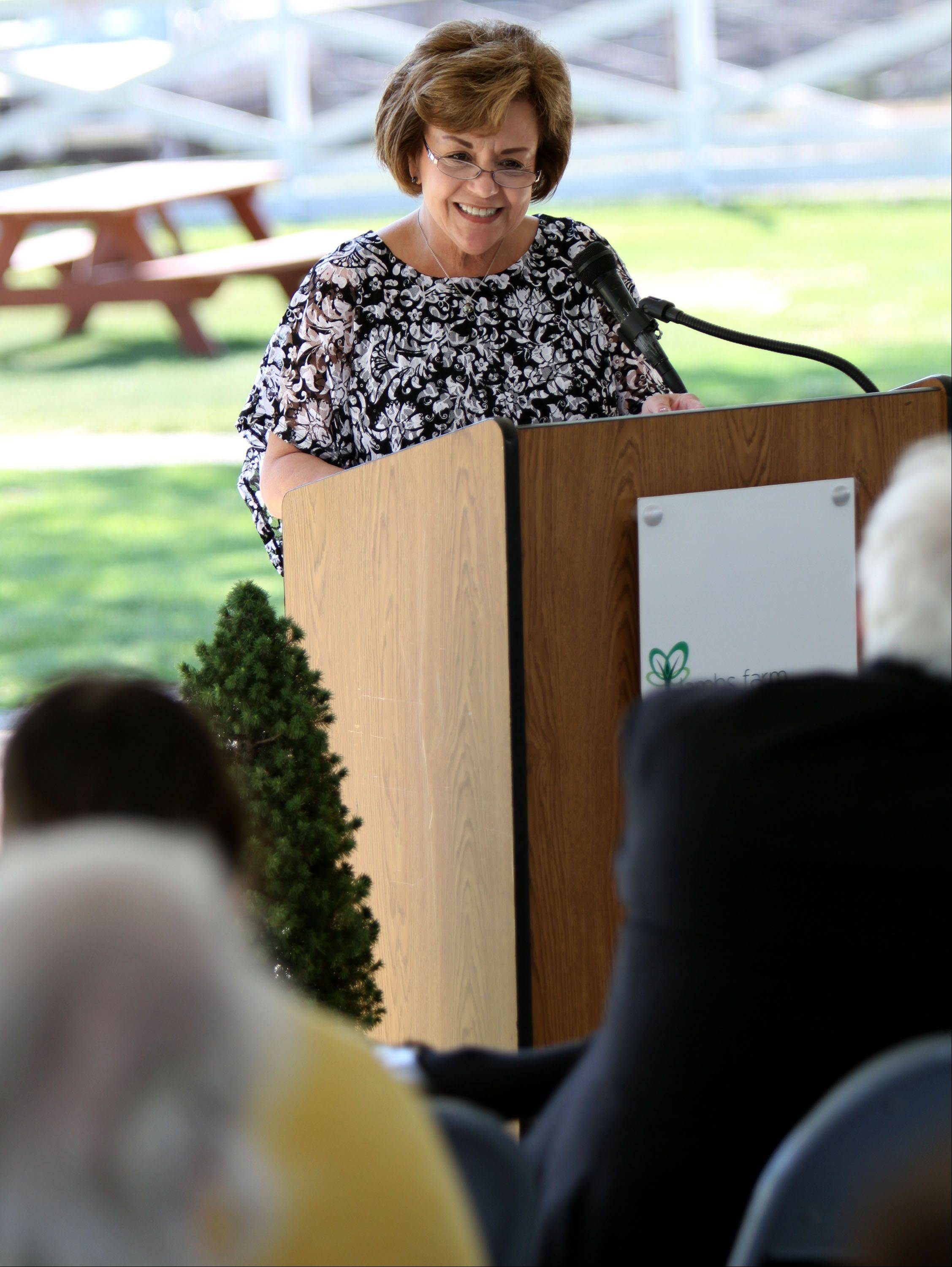 Dianne Yaconetti, president of Lambs Farm, speaks during a recent groundbreaking ceremony for a new Tribute Garden at the facility in Green Oaks.