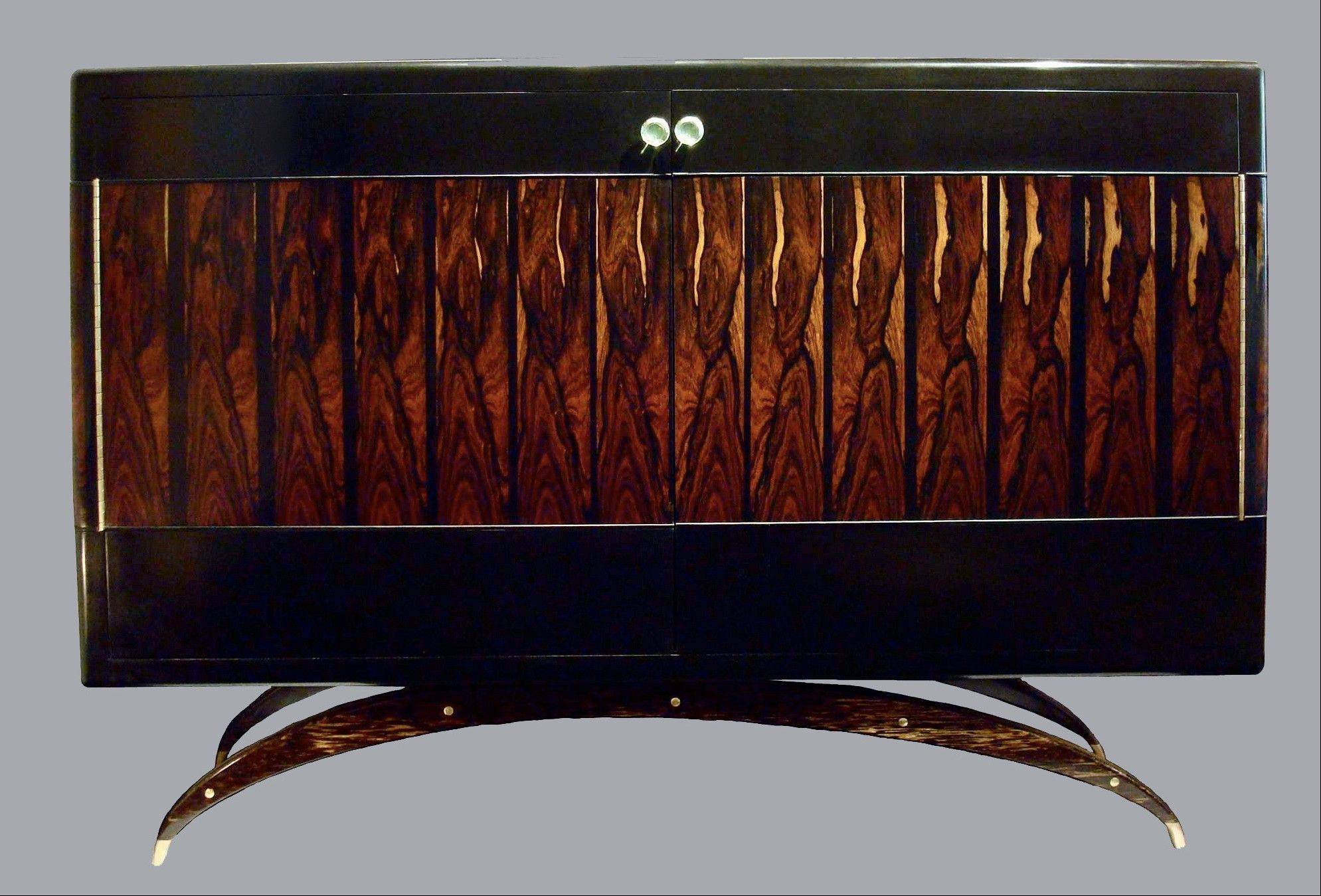 Artisanship meets whimsy in Antoine Shapira�s two-door Brazilian rosewood lacquered cabinet.