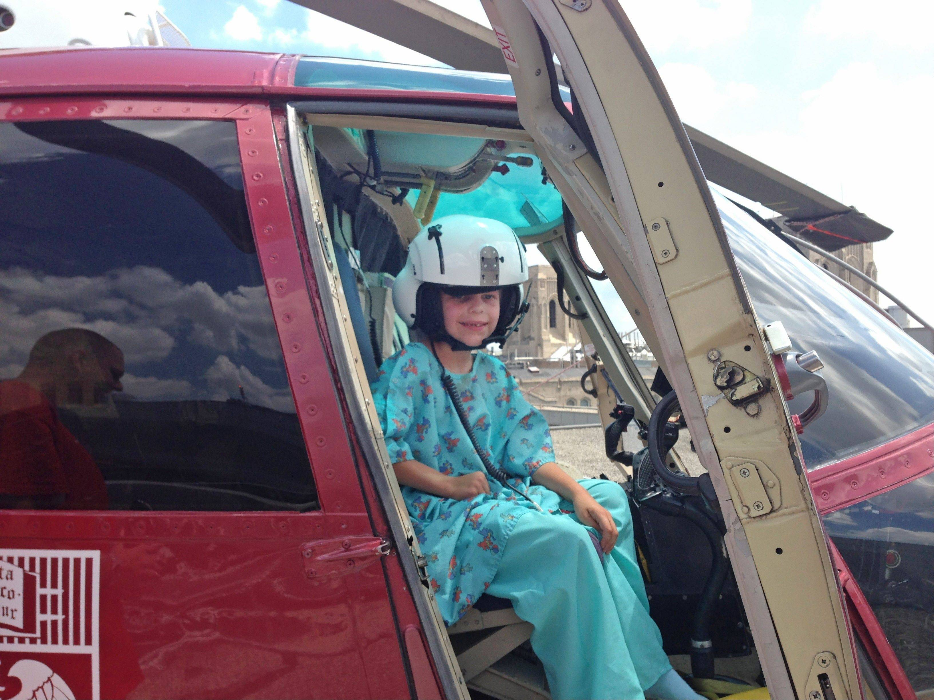 Nathan Woessner visits the Comer Children Hospital�s rooftop landing pad earlier this week. The boy survived being buried for more than three hours in a dune at Indiana Dunes National Lakeshore on July 12.