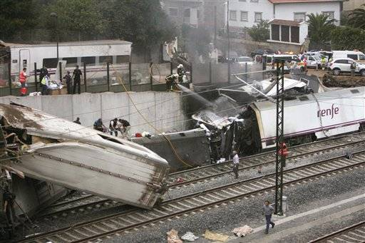 A train traveling in northwestern Spain derailed Wednesday night, toppling passenger cars on their sides and leaving at least one torn open as smoke rose into the air. It was not immediately clear how many people were hurt or had died, but Spanish National TV showed footage of what appeared to be several bodies covered by blankets alongside the tracks next to the wrecked train cars.