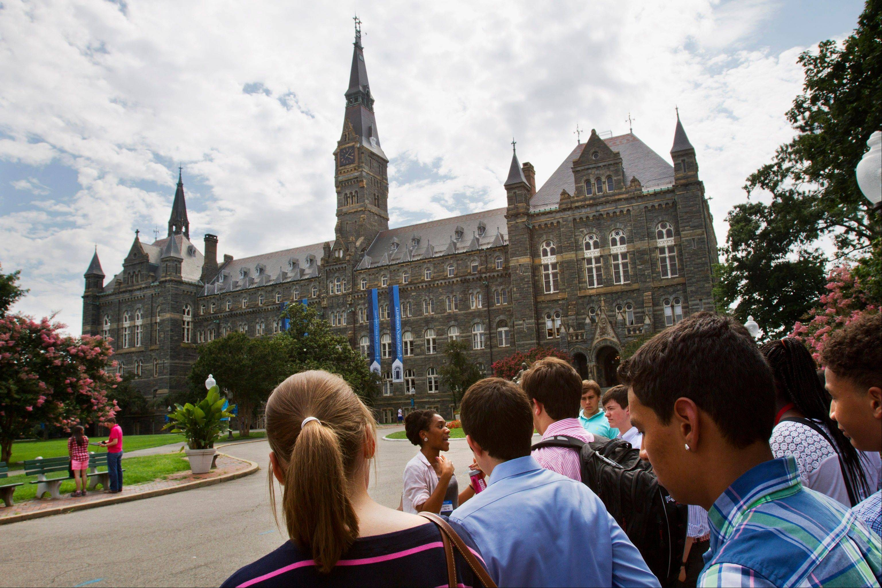 Prospective students tour Georgetown University's campus in Washington, in this Wednesday, July 10, 2013, file photo. The Senate was weighing legislation Wednesday, July 24, 2013, that would link interest rates to the financial markets, providing lower rates for all college students this fall but perhaps resulting in higher rates in the years ahead.