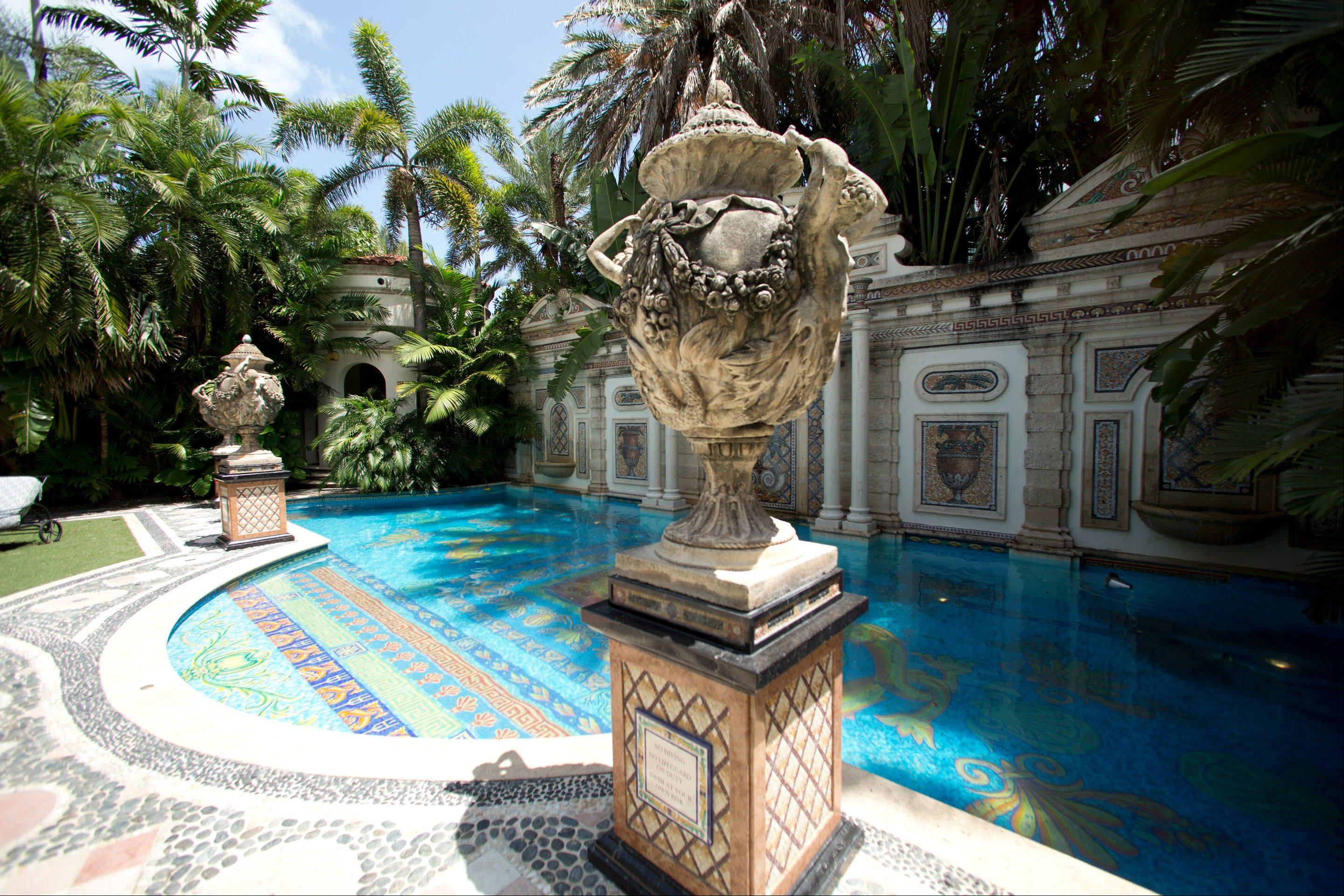 Decorative artwork stands in front of the 55 foot long swimming pool at the Versace mansion on Miami Beach, Fla.