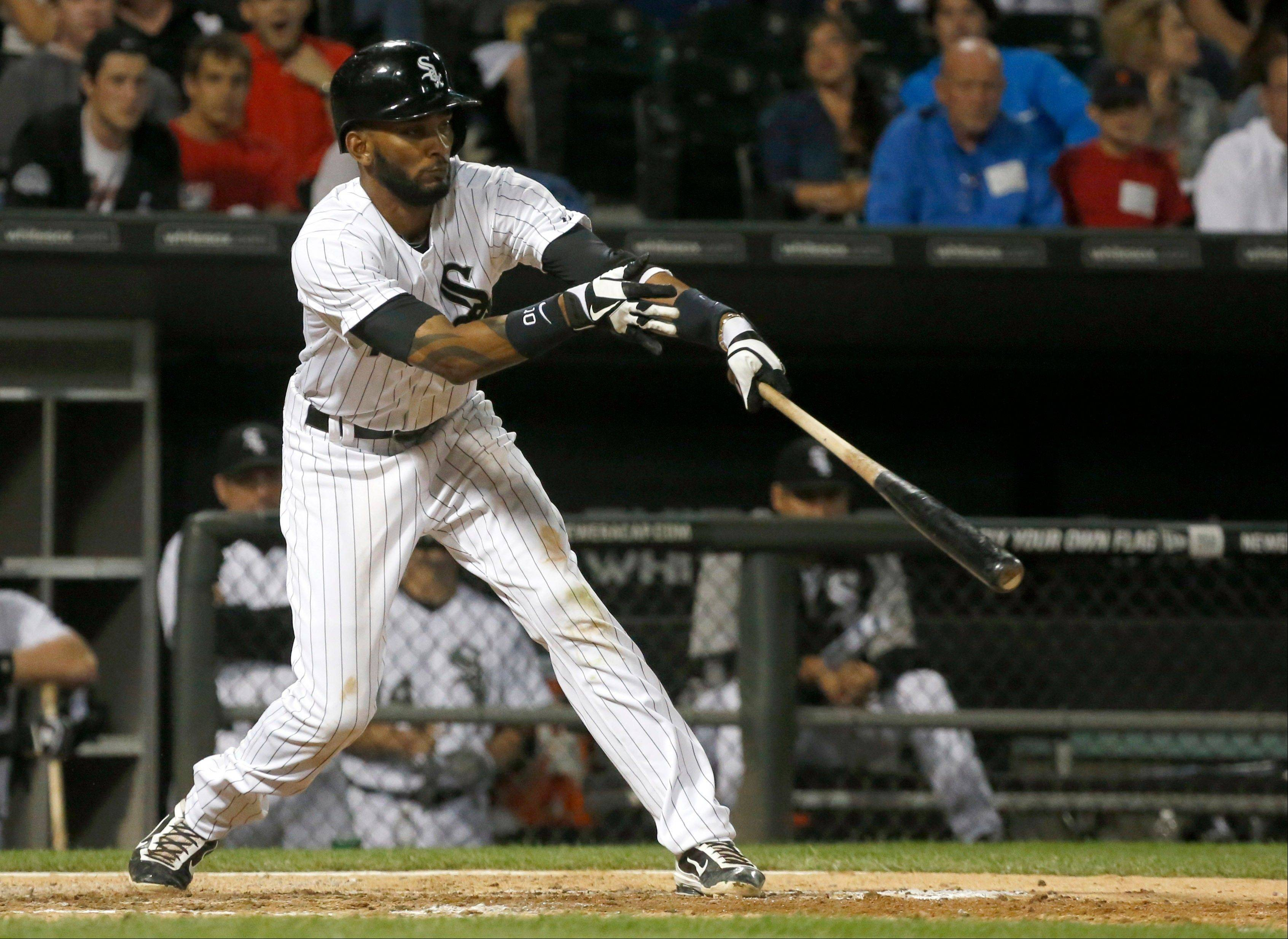 Chicago White Sox's Alexei Ramirez swings on an RBI single off Detroit Tigers relief pitcher Bruce Rondon during the seventh inning of a baseball game Wednesday, July 24, 2013, in Chicago. (AP Photo/Charles Rex Arbogast)