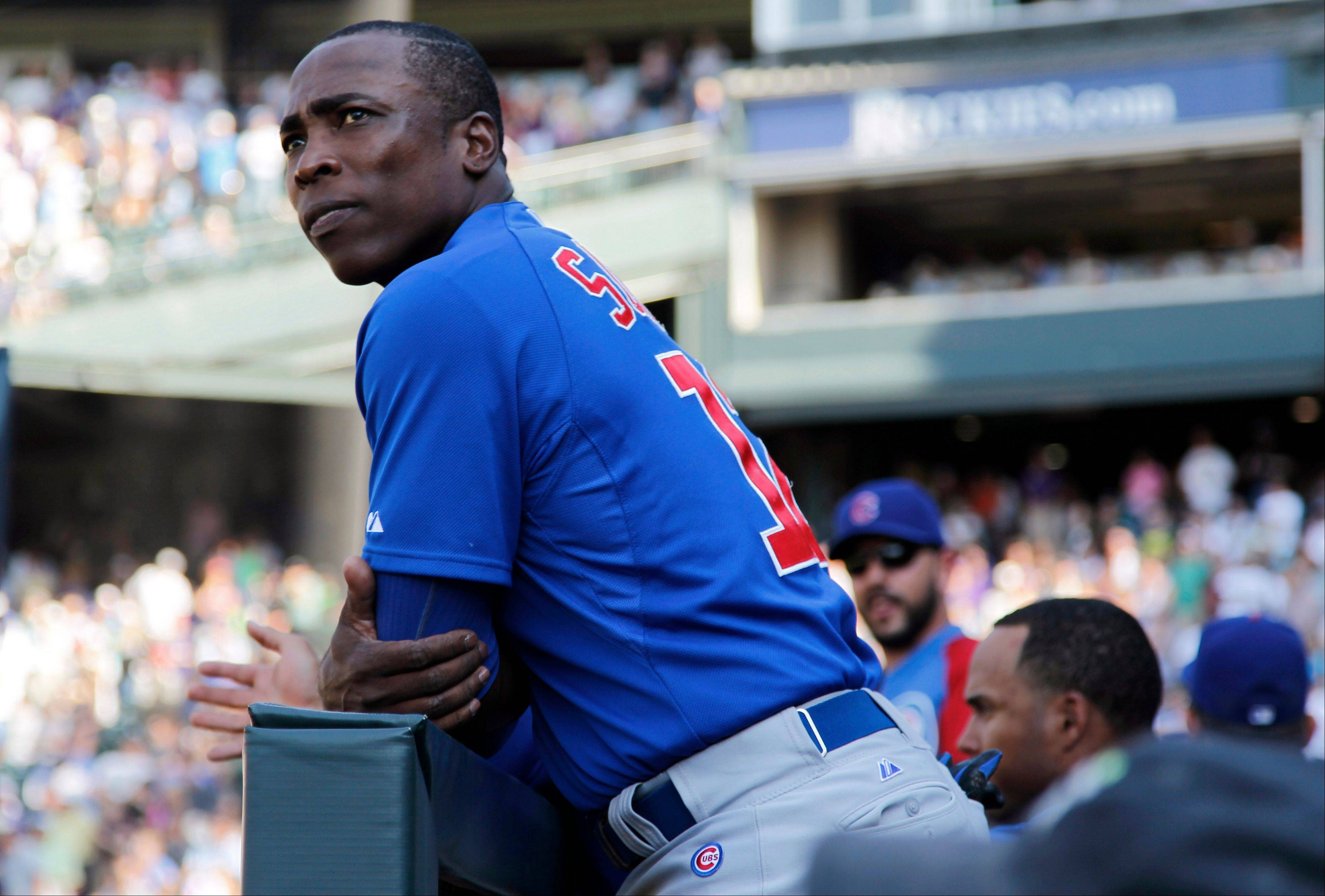 Chicago Cubs left fielder Alfonso Soriano leans against the front of the dugout as the Cubs were down to their final out against the Colorado Rockies in a baseball game in Denver on Sunday, July 21, 2013. The Rockies won 4-3. (AP Photo/David Zalubowski)