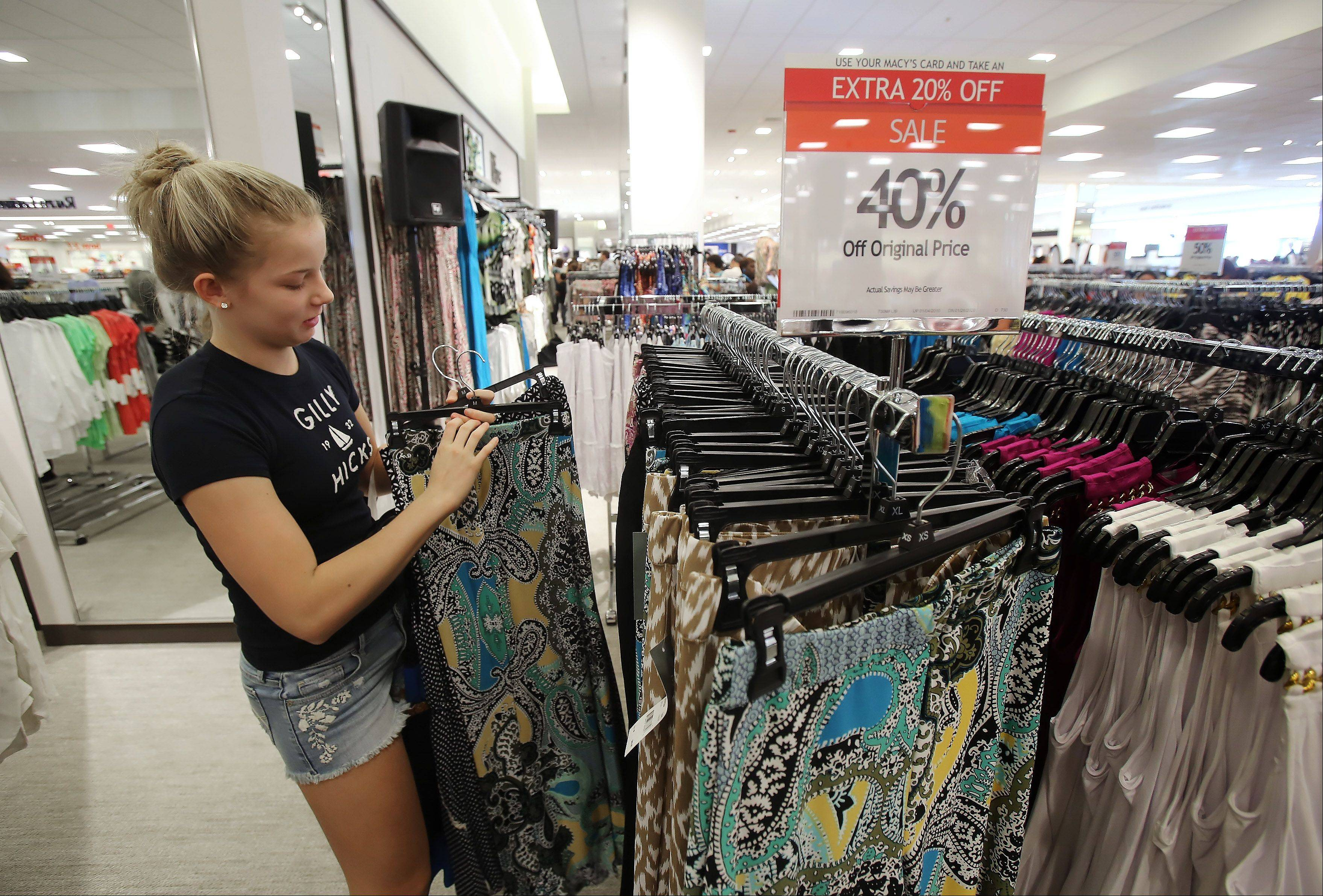Taylor Adkins, 15, of Round Lake Beach shops during Wednesday's grand opening of Macy's in Gurnee Mills. The first 300 customers received a store gift card.
