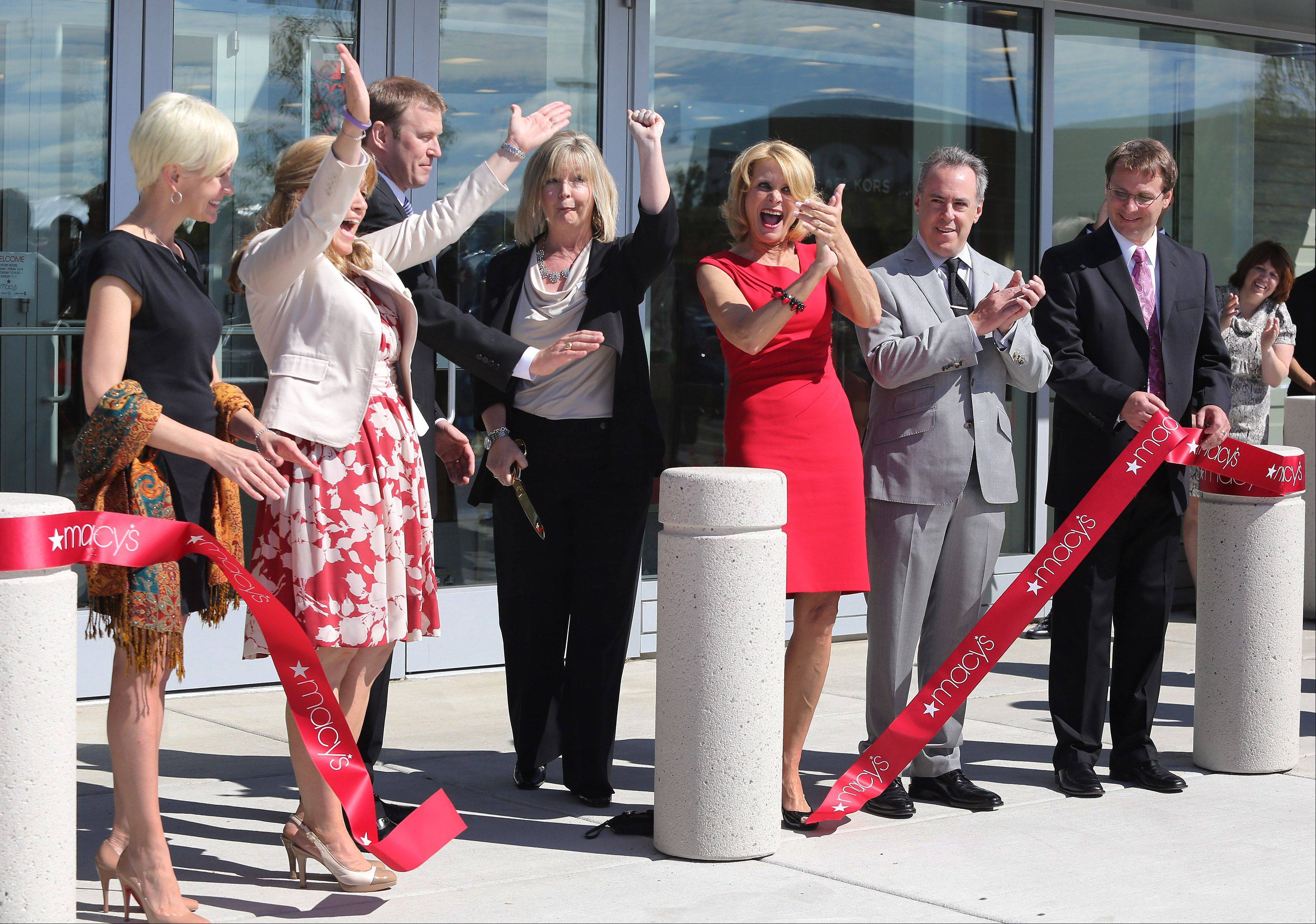 Gurnee village officials, Macy's executives and Gurnee Mills representatives celebrate during ribbon-cutting ceremony at Wednesday's grand opening of Macy's in Gurnee Mills.