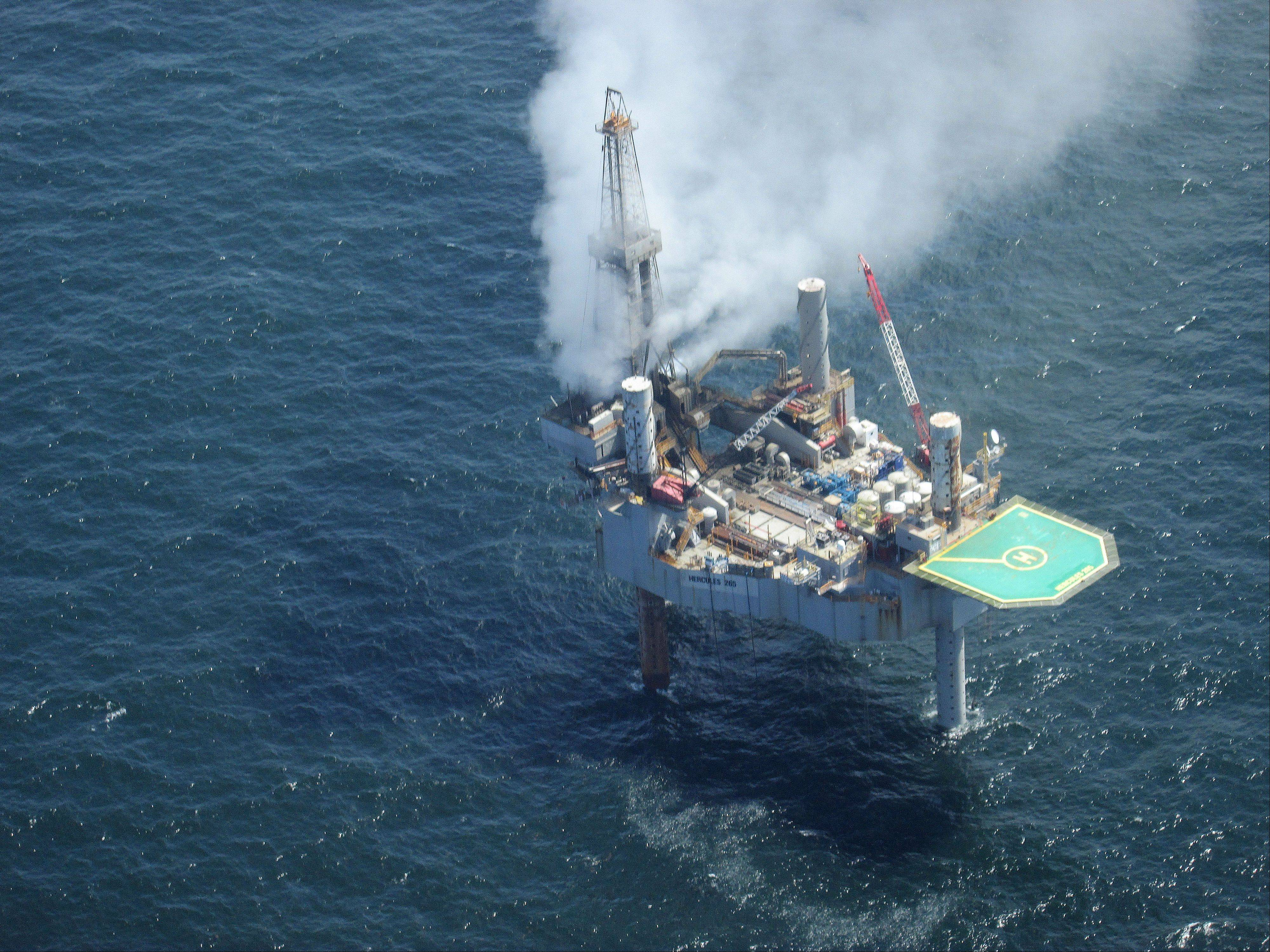 Natural gas spewing from the Hercules 265 drilling rig in the Gulf of Mexico off the coast of Louisiana, Tuesday, July 23, 2013. No injuries were reported in the midmorning blowout, about 55 miles off the Louisiana coast in the Gulf of Mexico.