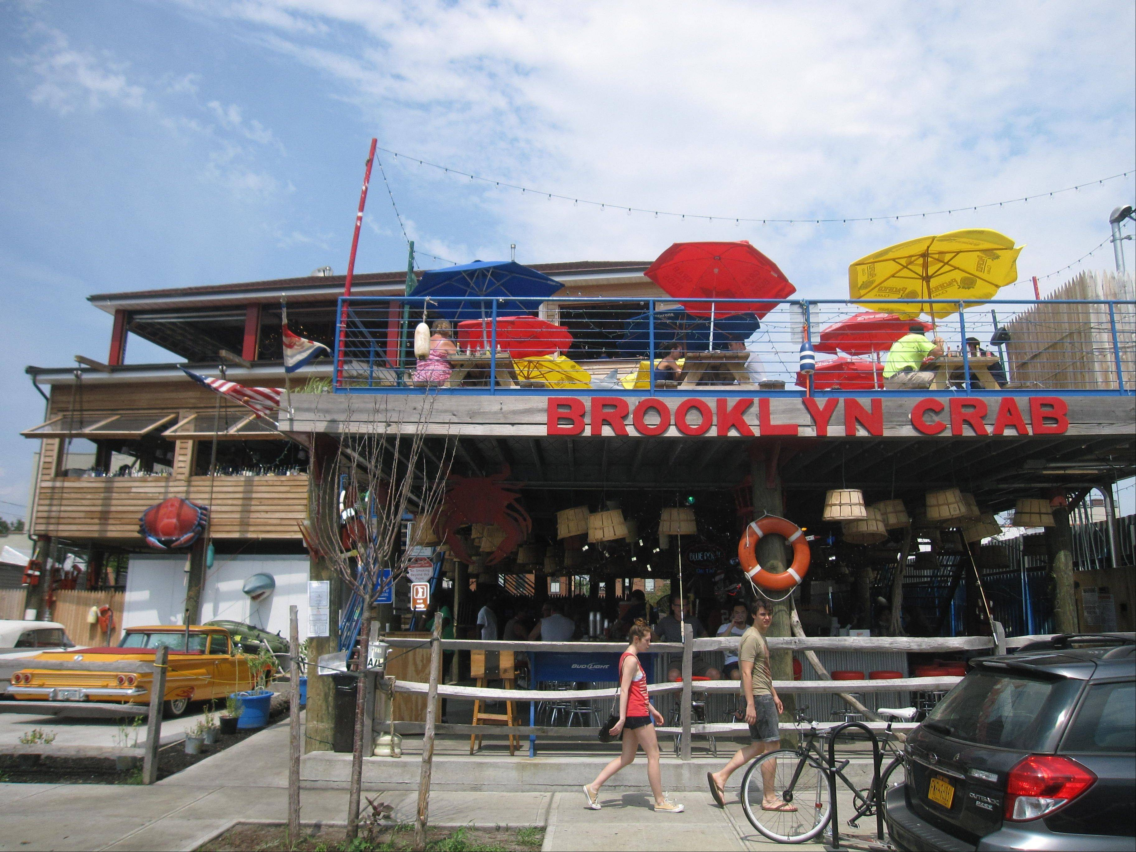Brooklyn Crab in Red Hook is located across from old brick warehouses that now house a supermarket in New York City.