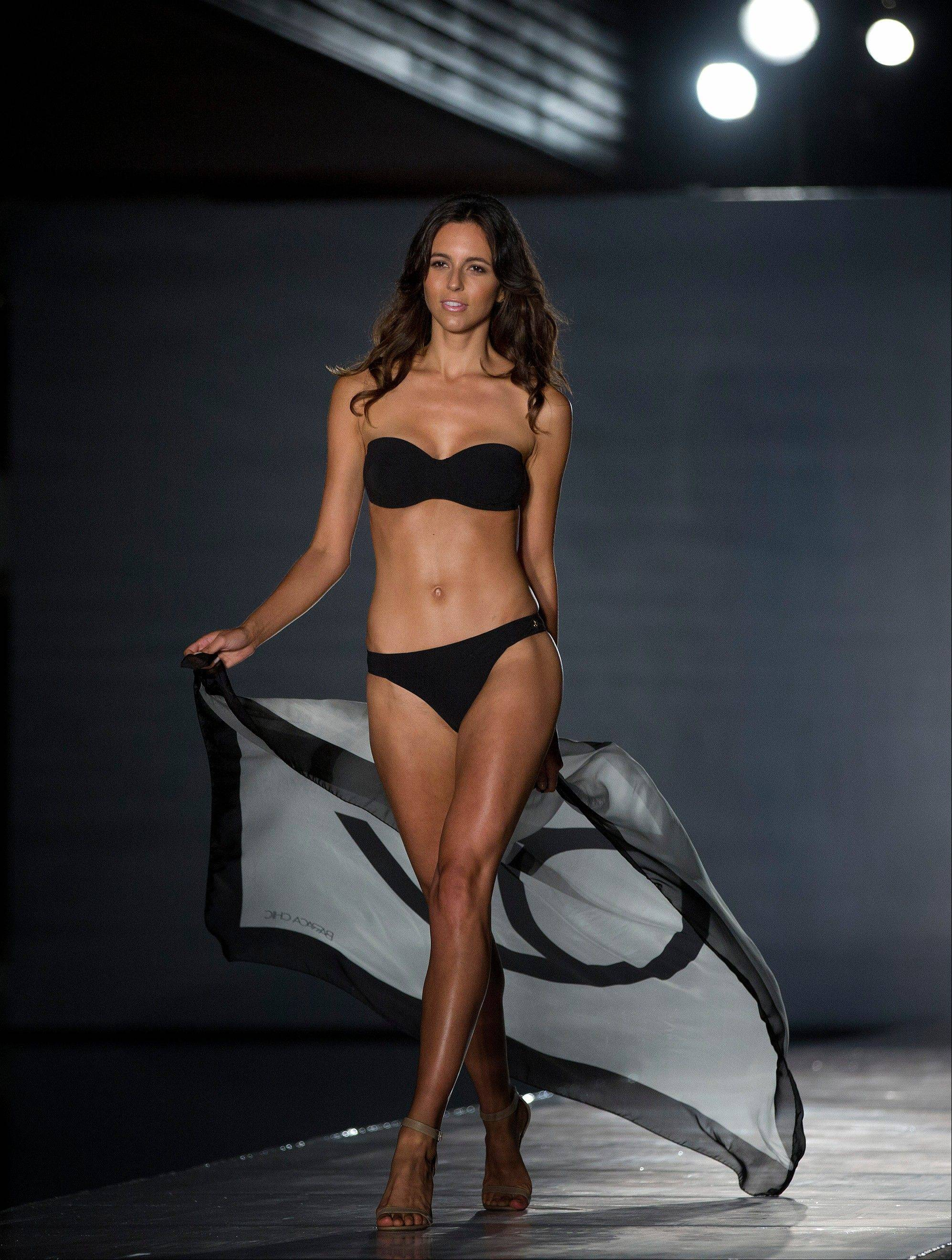 A model walks the runway wearing Barraca Chic swimwearin the MBFW Swim fashion show in Miami Beach.