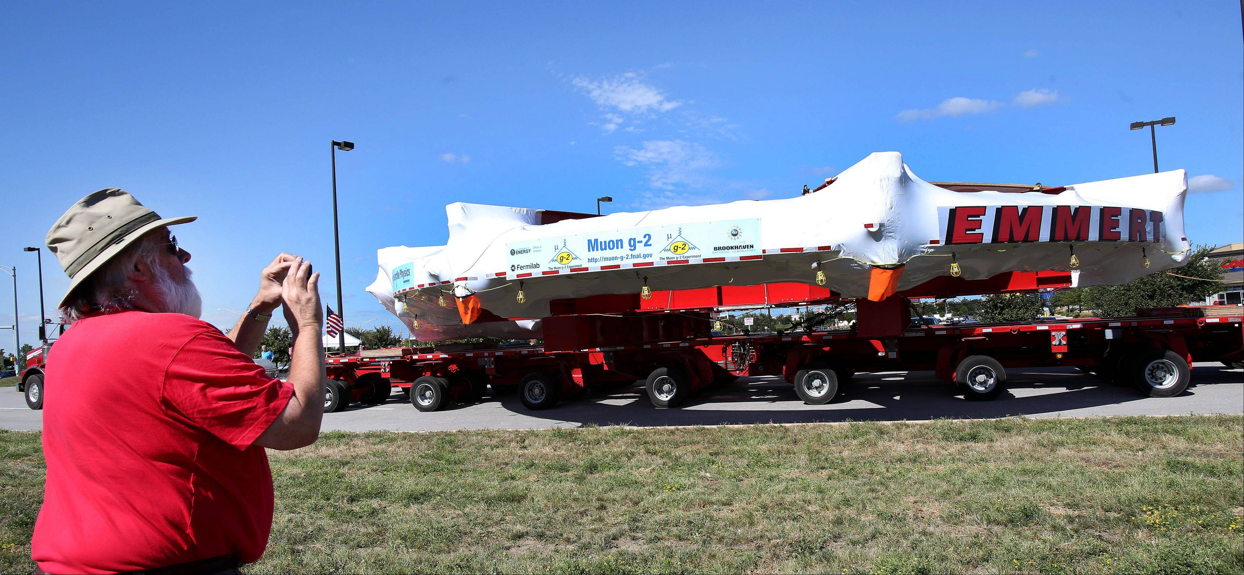 Chris Otis of Woodridge gets a panoramic shot of a 50-ft-wide magnet making its way from Brookhaven National Laboratory in New York to Fermilab in Batavia. It made a stop on Wednesday at the Costco parking lot in Bolingbrook.