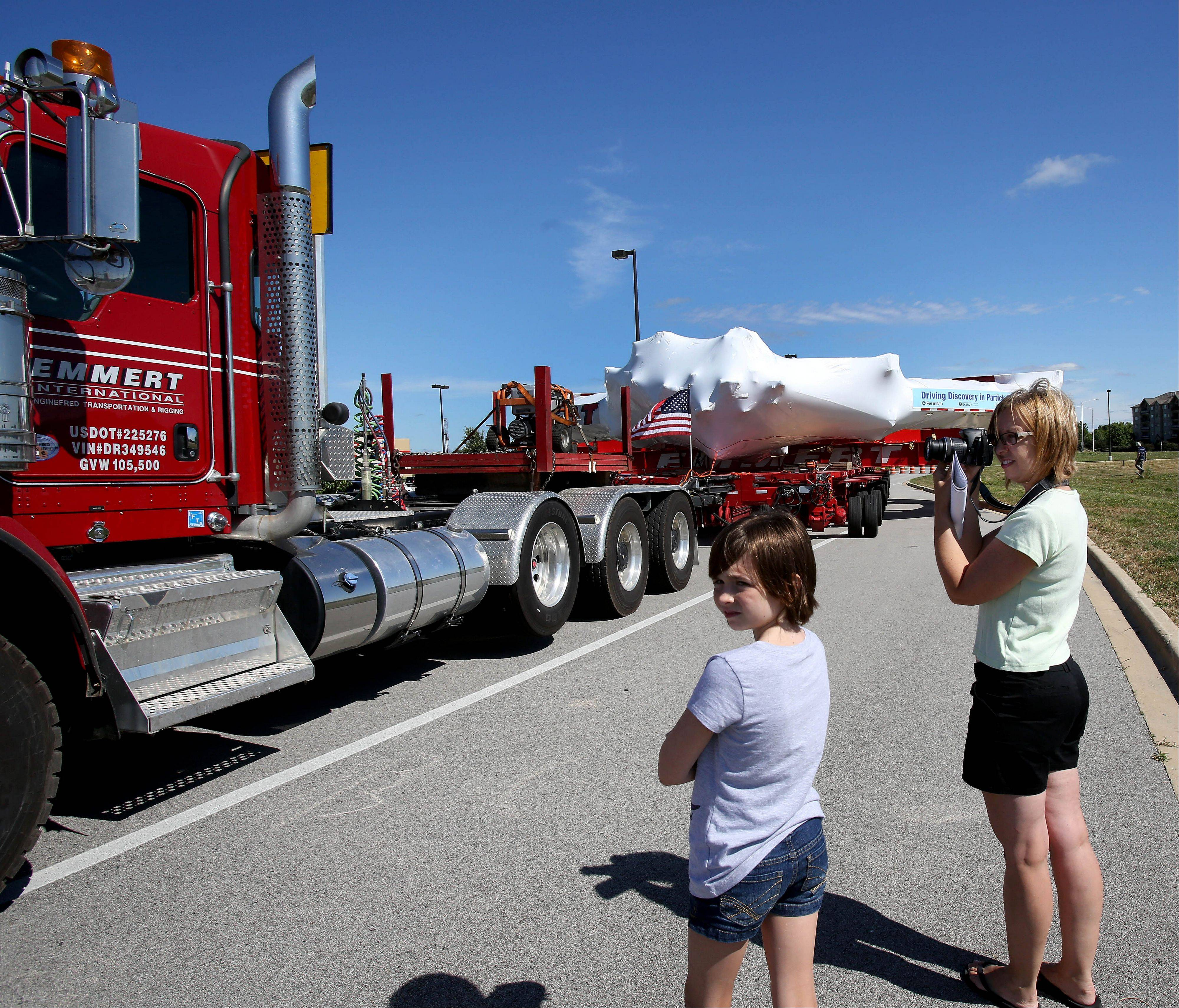 Lisa Wheaton of Bolingbrook and her daughter Amelia, 10, get some photos of the magnet as it made a stop on Wednesday at the Costco parking lot in Bolingbrook.