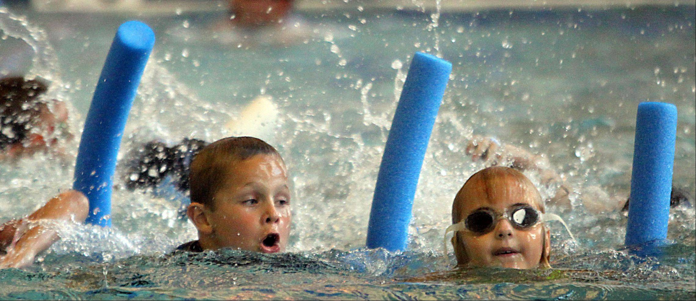 Athletes complete the 100-yard swim during the Juniors event that was part of the MMTT Splash and Dash race at Cadence Fitness and Health Center in Geneva Wednesday night.