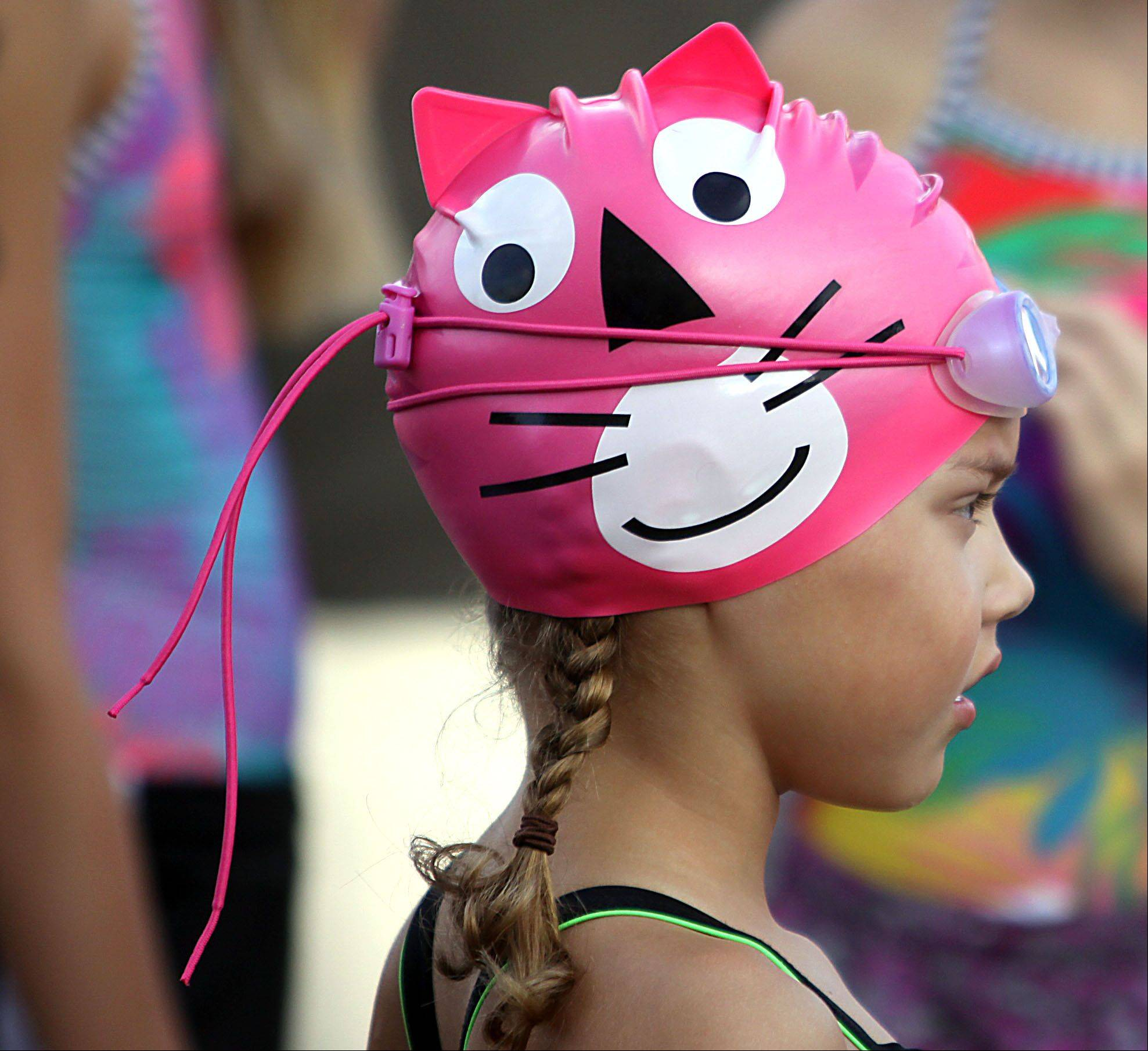 Makenna Cowhey, 7, of Geneva sports a kitty-themed swim cap for the Juniors event that was part of the MMTT Splash and Dash race at Cadence Fitness and Health Center in Geneva Wednesday night.