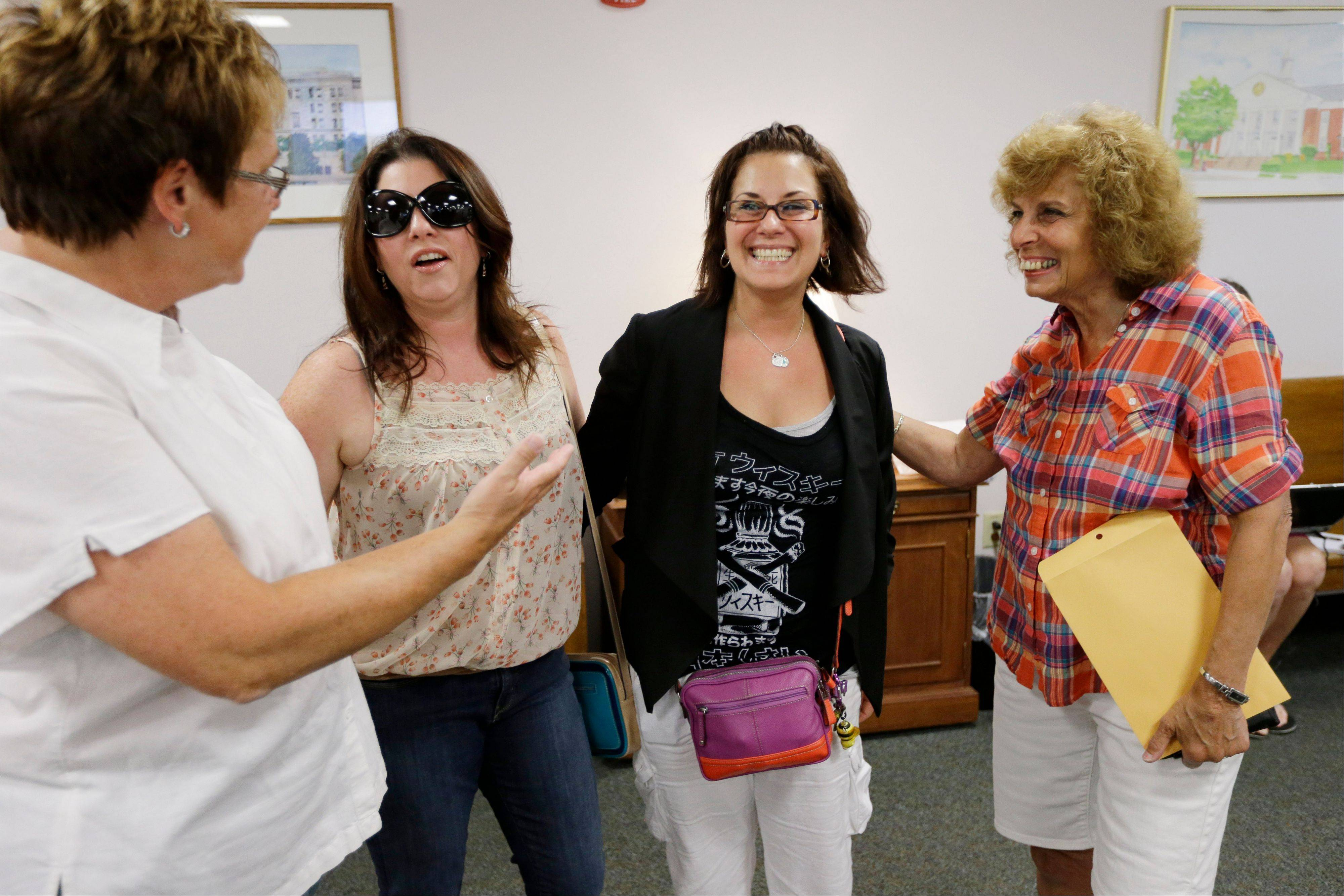 Ellen Toplin, left, and Charlene Kurland, right, who obtained a marriage license at a Montgomery County office despite a state law banning such unions, meet with Nicola Cucinotta, center left, and Tamara Davis before they get their license, Wednesday, July 24, 2013, in Norristown, Pa. Five same-sex couples have obtained marriage licenses in the suburban Philadelphia county that is defying a state ban on such unions.