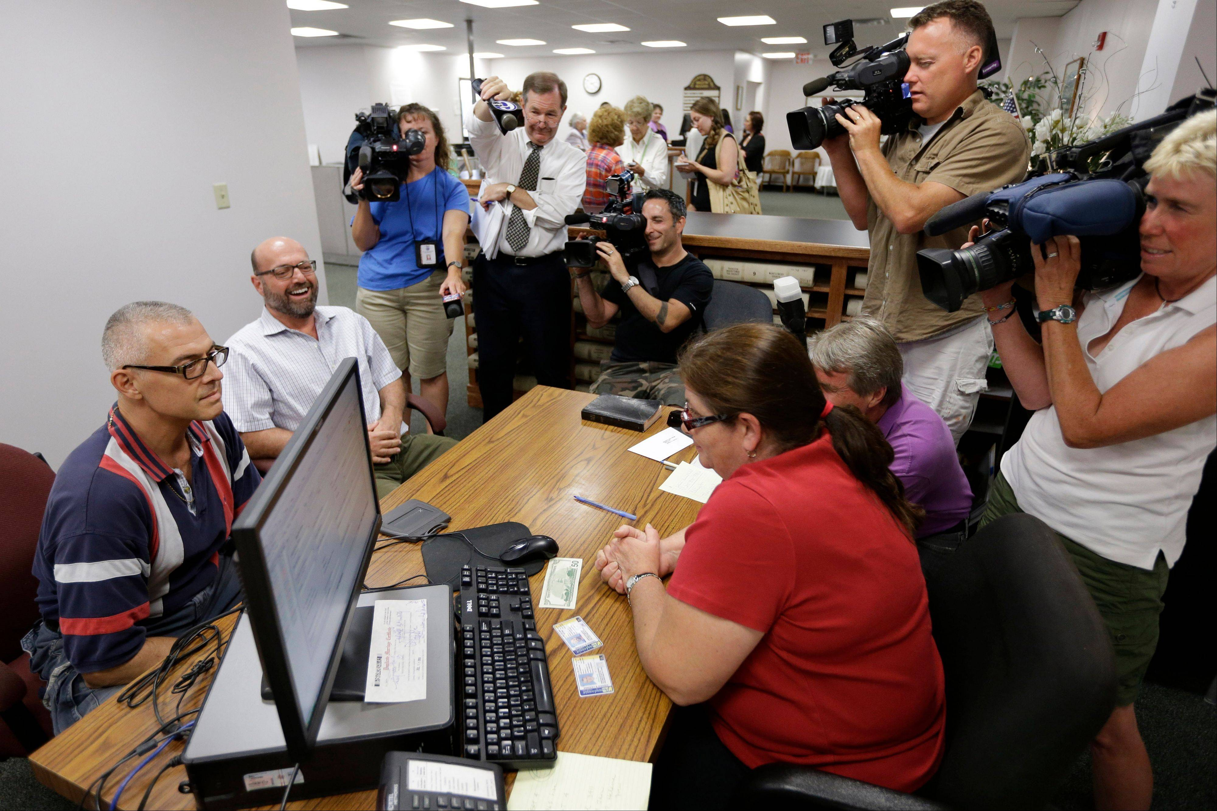 Marcus Saitschenko, left, and James Goldstein obtain a marriage license at a Montgomery County office despite a state law banning such unions, Wednesday, July 24, 2013, in Norristown, Pa. Five same-sex couples have obtained marriage licenses in the suburban Philadelphia county that is defying a state ban on such unions.