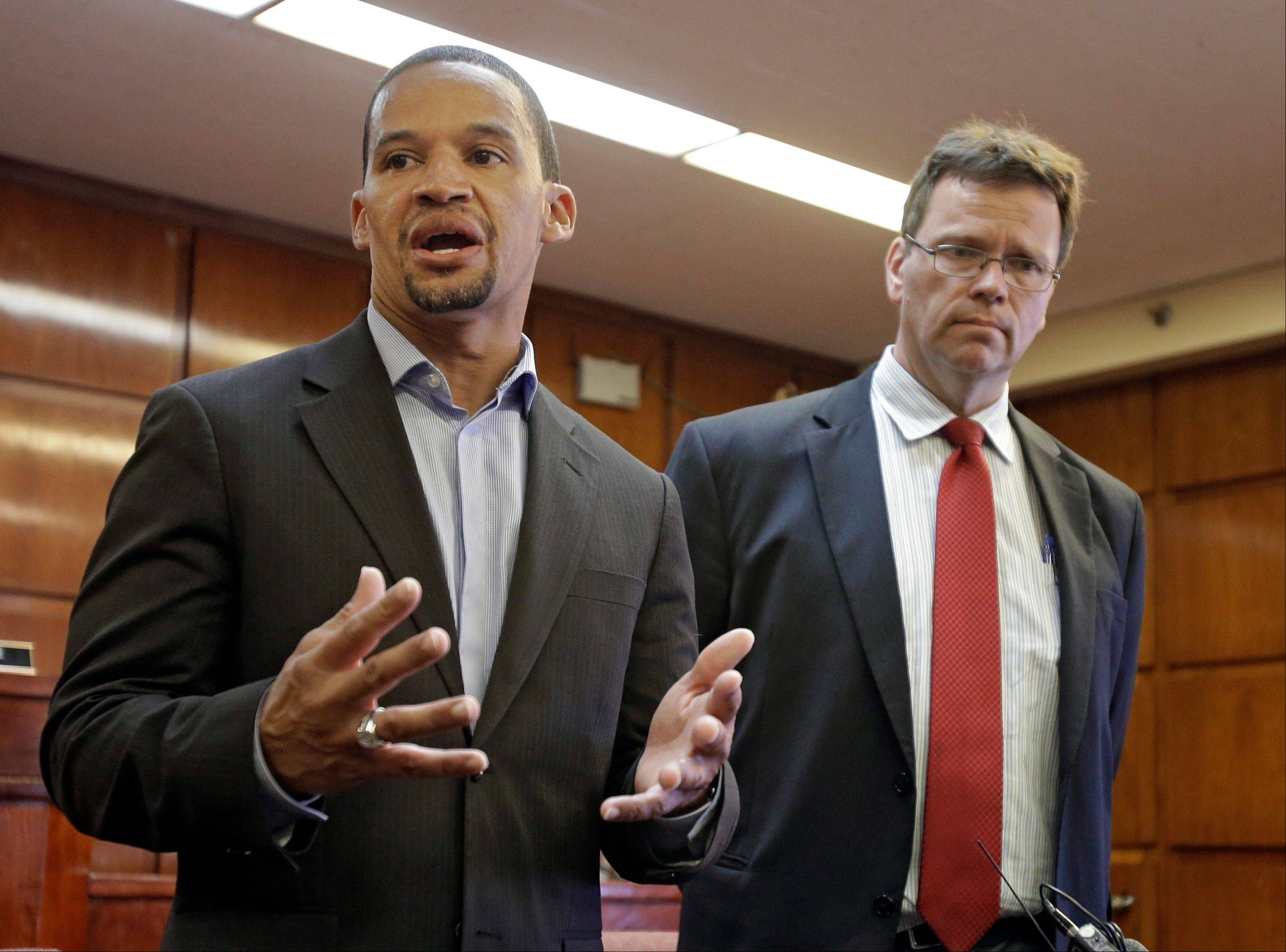 East Cleveland Mayor Gary Norton, left, speaks during a news conference with Cuyahoga County Medical Examiner Dr. Thomas Gilson, in East Cleveland, Ohio, Tuesday, July 23, 2013. Norton announced that Shetisha Sheeley, 28, has been identified as the second of three murdered women found in trash bags in the city.