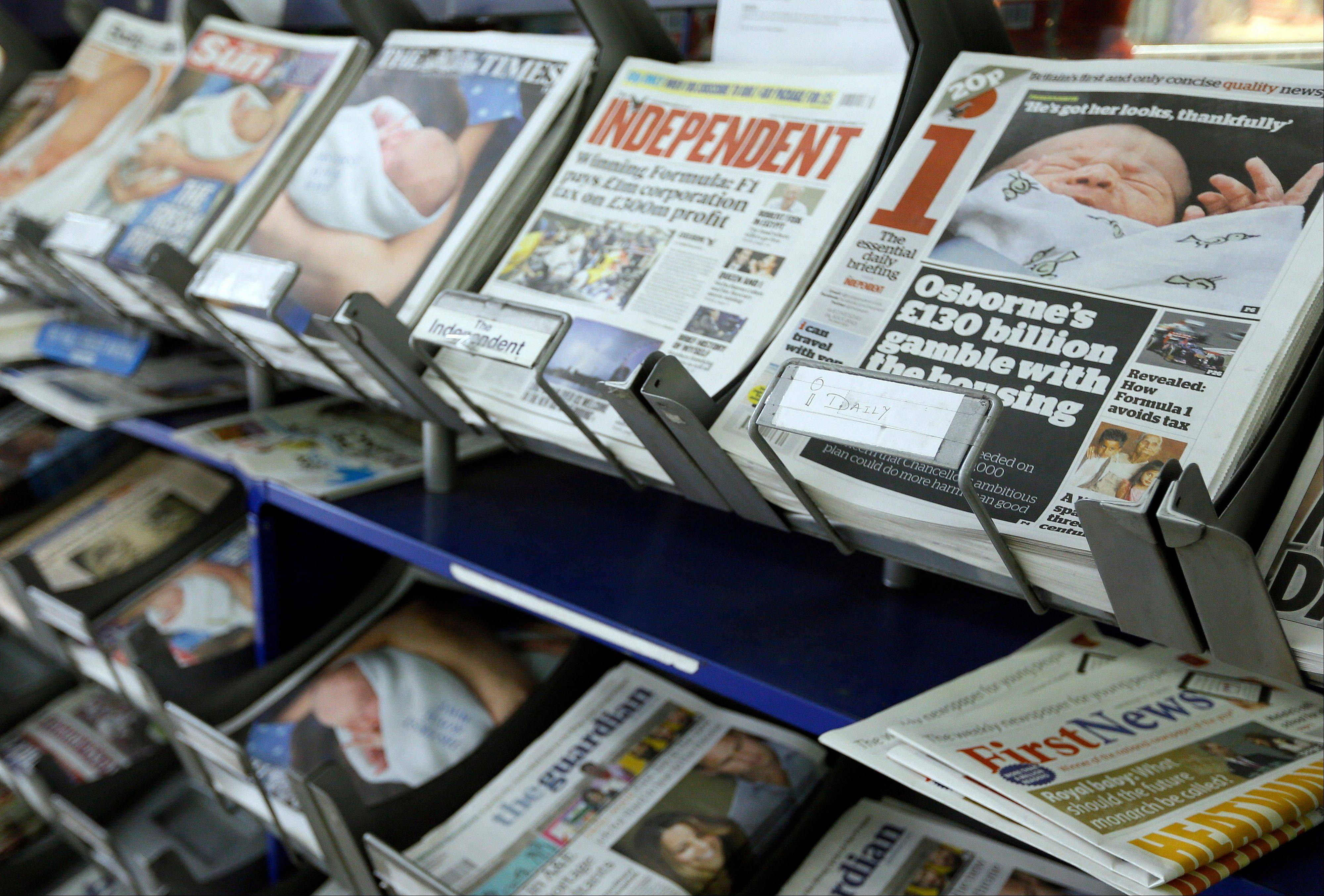 British newspapers are displayed for sale in London, Wednesday, July 24, 2013. The newspapers show coverage of the new royal baby boy, third in line to the throne.