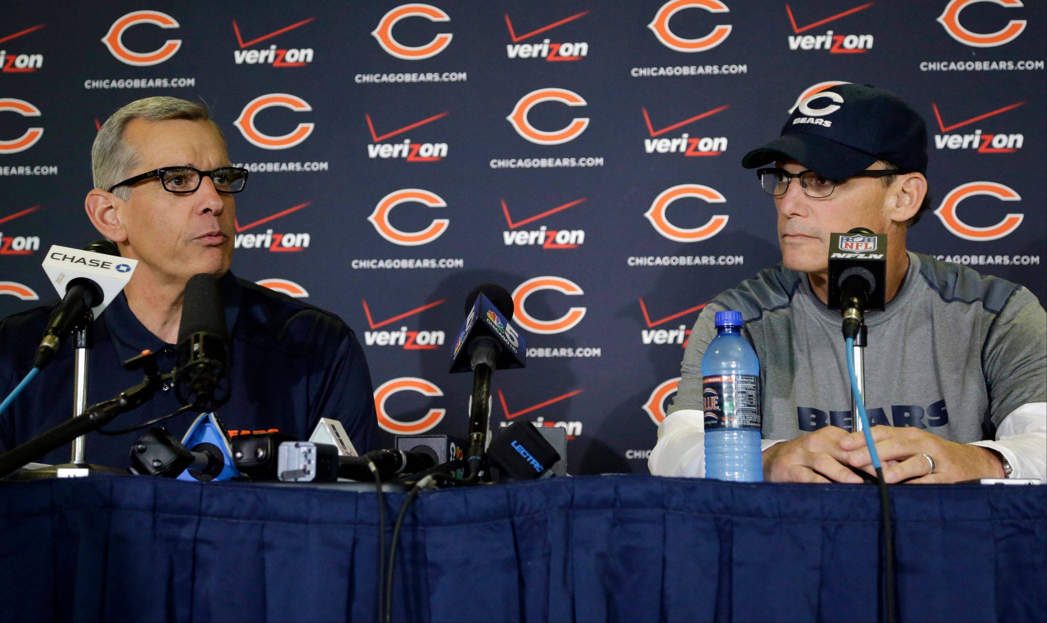 Chicago Bears general manager Phil Emery, left, and coach Marc Trestman listen to questions during an NFL football news conference on Wednesday, July 24, 2013, in Bourbonnais, Ill.