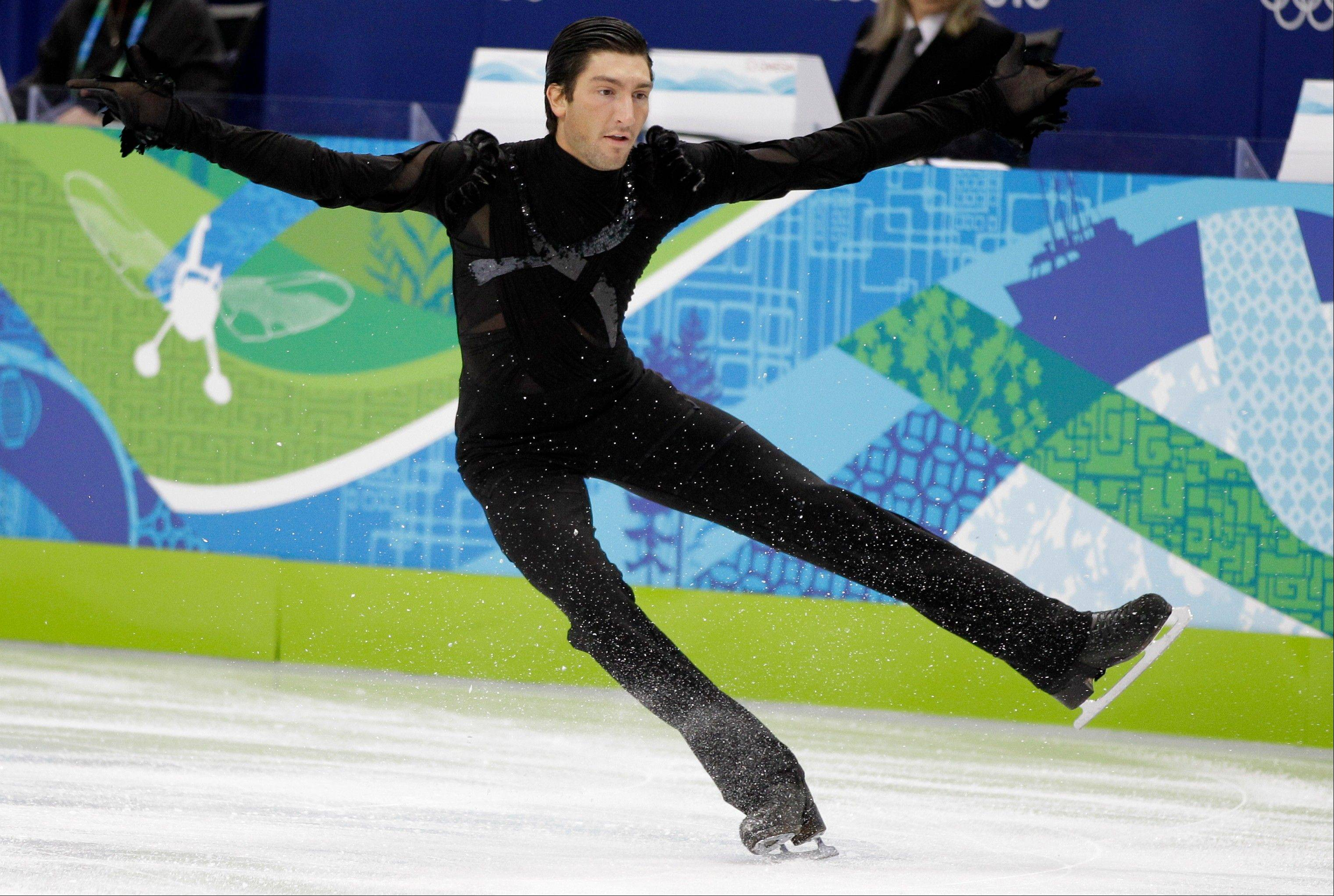 FILe- In this Feb. 16, 2010, file photo, USA's Evan Lysacek performs his short program during the men's figure skating competition at the Vancouver 2010 Olympics in Vancouver, British Columbia. It's been more than three years since Lysacek skated off with the gold medal in Vancouver. The next Olympics are 6 1-2 months away, and Lysacek is preparing to defend his title, something no male figure skater has done since 1952.