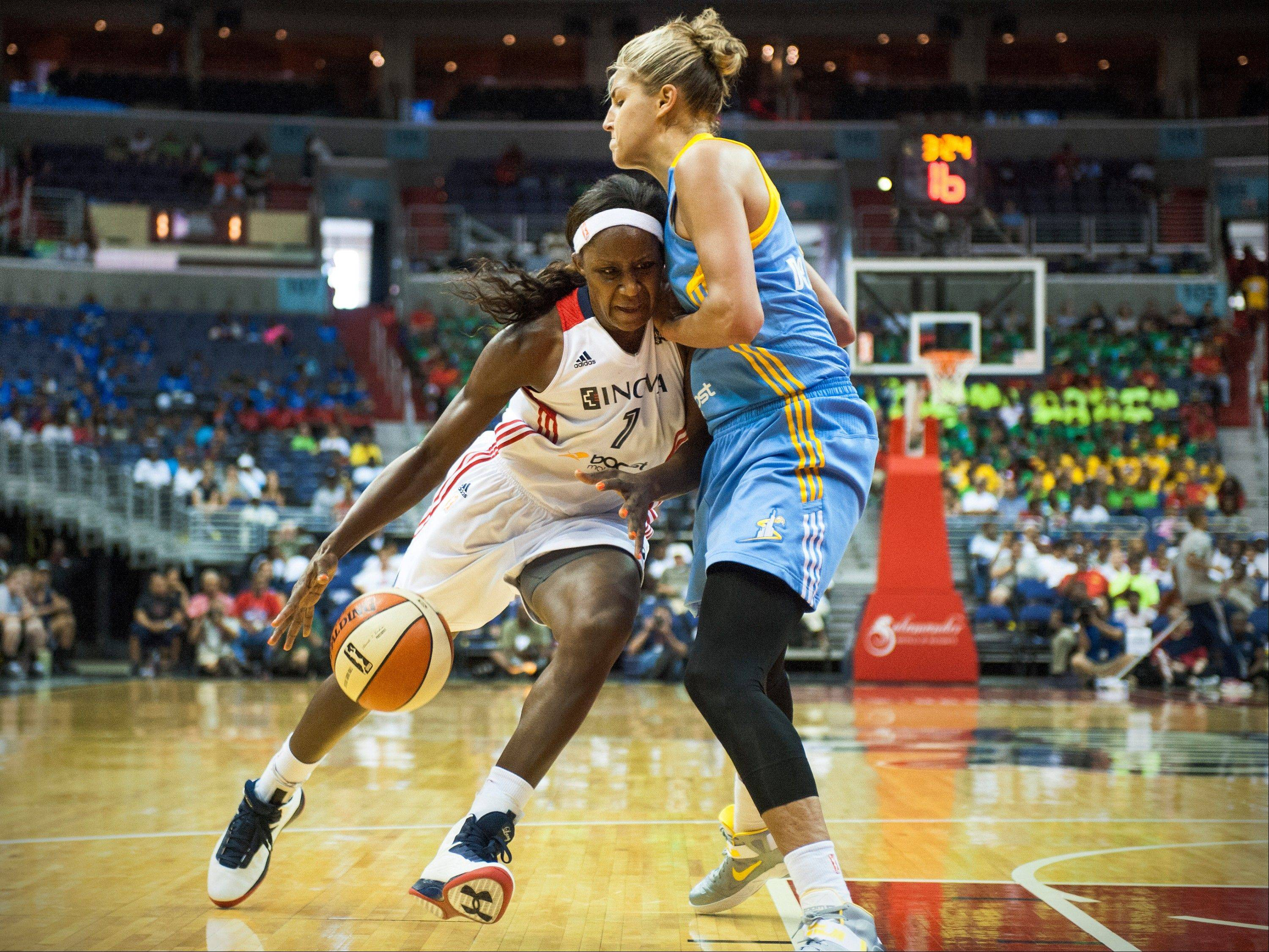 Washington Mystics' Crystal Langhorne (1) drives against Chicago Sky's Elena Delle Donne (11) during the second half of a WNBA basketball game at Verizon Center Wednesday, July 24, 2013 in Washington. The Mystics won 82-78. (AP Photo/The Washington Post, Katherine Frey) MANDATORY CREDIT; WASHINGTON TIMES OUT; NEW YORK TIMES OUT;THE WASHINGTON EXAMINER AND USA TODAY OUT; MAGS OUT; NO SALES
