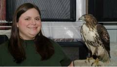Laura Kirk, Education Director at Fox Valley Wildlife Center holds one of the center's residents.  Laura will be working with students from Fox Valley Jewish School this Fall as the children take on several projects to further the center's mission of caring for injured wildlife.