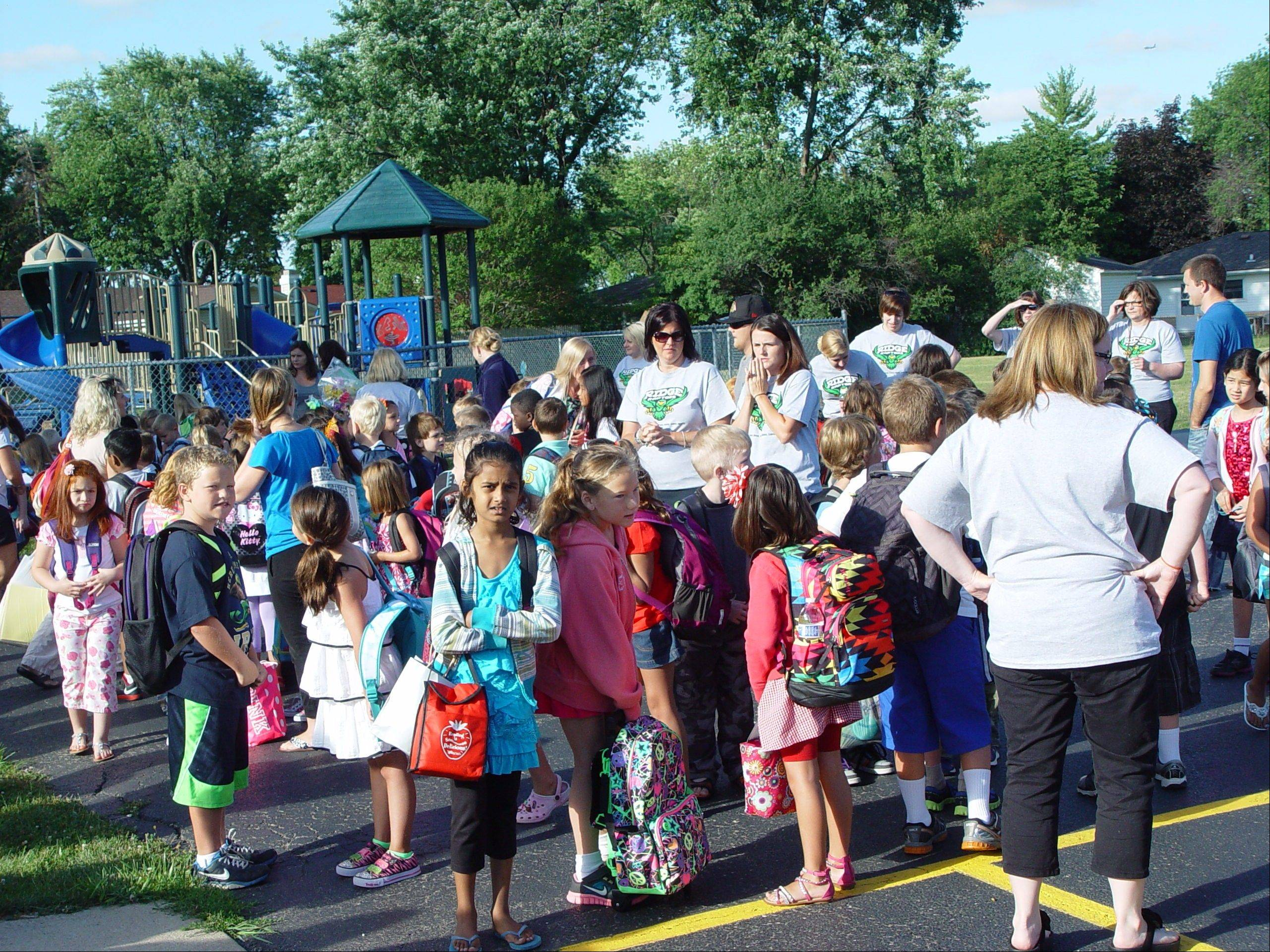 Students gather to start a new school year Wednesday at Ridge Family Center for Learning in Elk Grove Village. The school operates year-round.