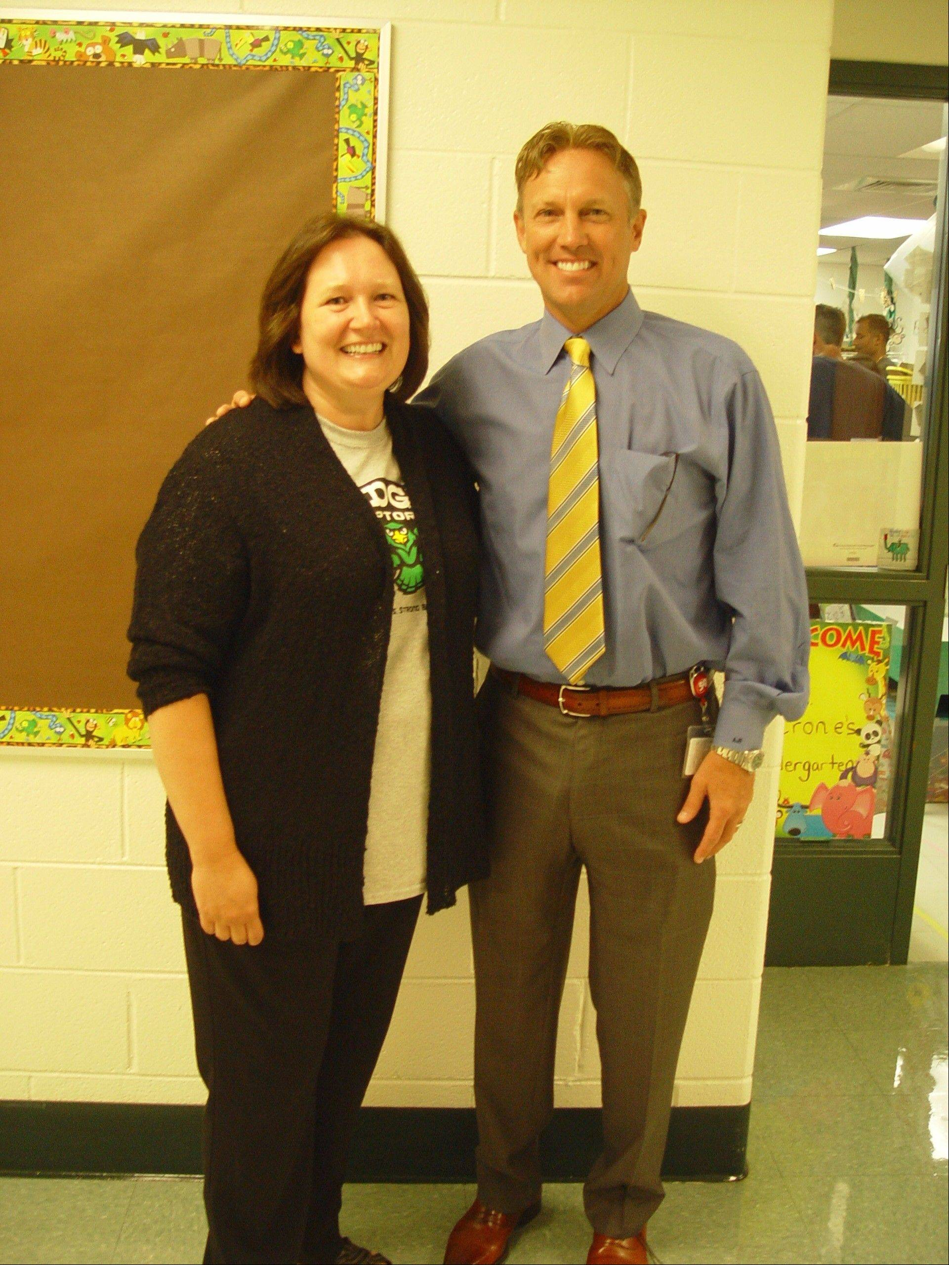 Ridge Family Center for Learning Principal Michele Ramsey and Art Fessler, the new superintendent of Elk Grove Township District 59, were on hand Wednesday to welcome staff and families to the new school year. Ramsey took over July 1 from interim superintendent Mark Friedman.